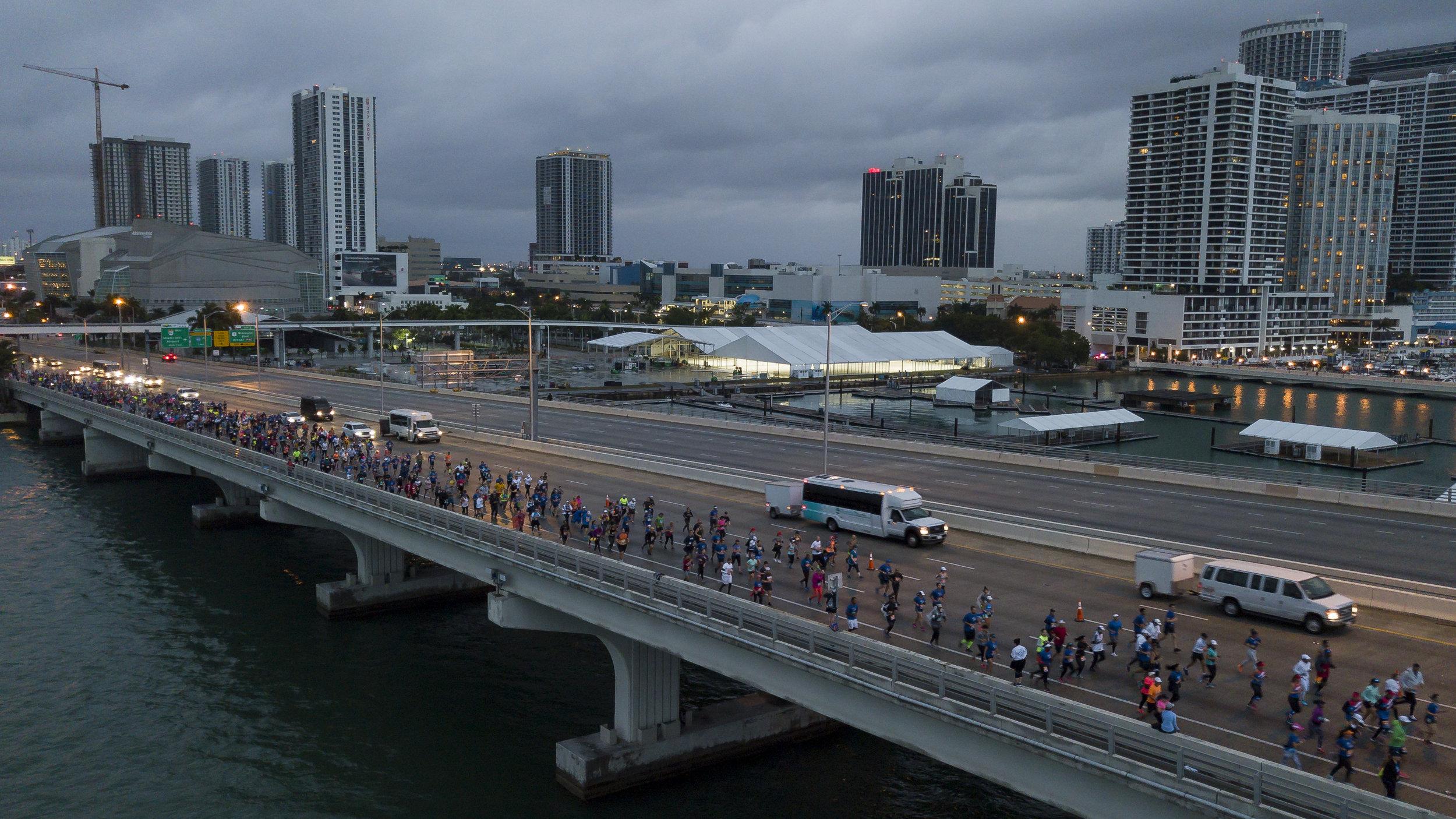 Runners make their way across the MacArthur Causeway toward Watson Island during the Miami Marathon & Half Marathon on Sunday, Jan. 27, 2019.
