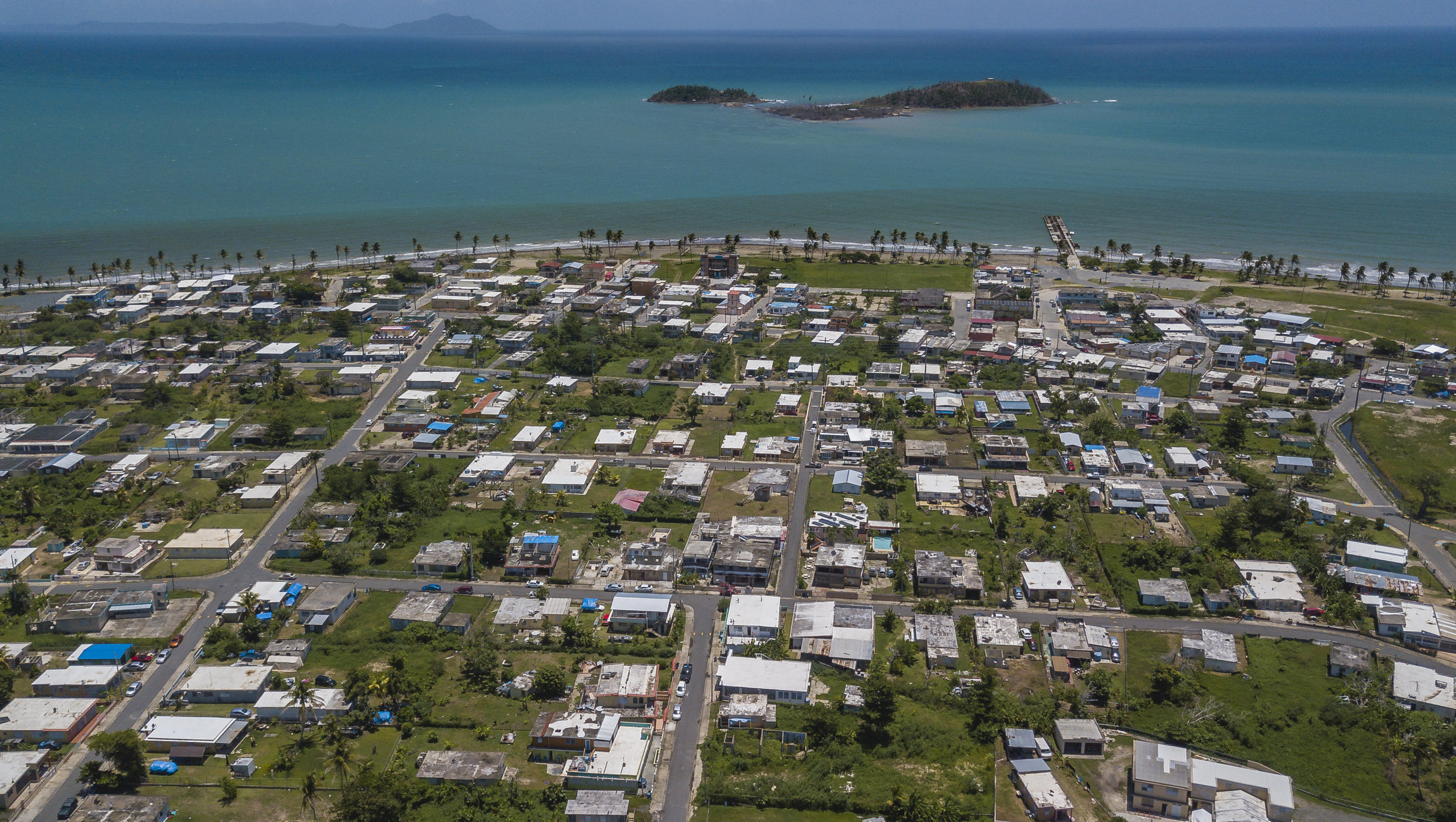 Punta Santiago, Humacao on August 23, 2018. Hurricane Maria devastated the seaside community and a year later homes with blue tarps await new roofs.