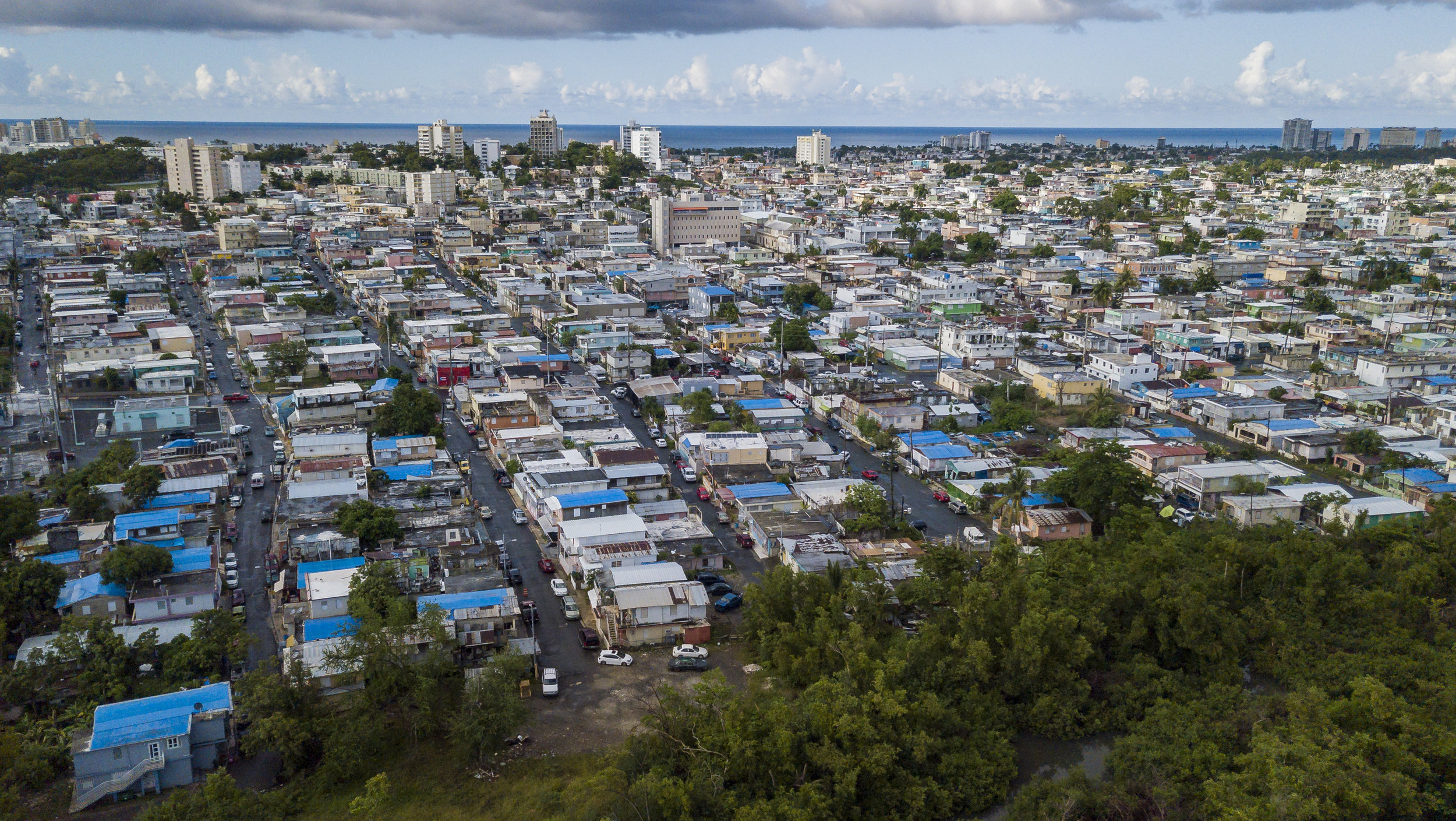 Many homes in the Caño Martin Peña communities in San Juan, Puerto Rico still lack permanent roofs on August 24, 2018 a year after Hurricane Maria.