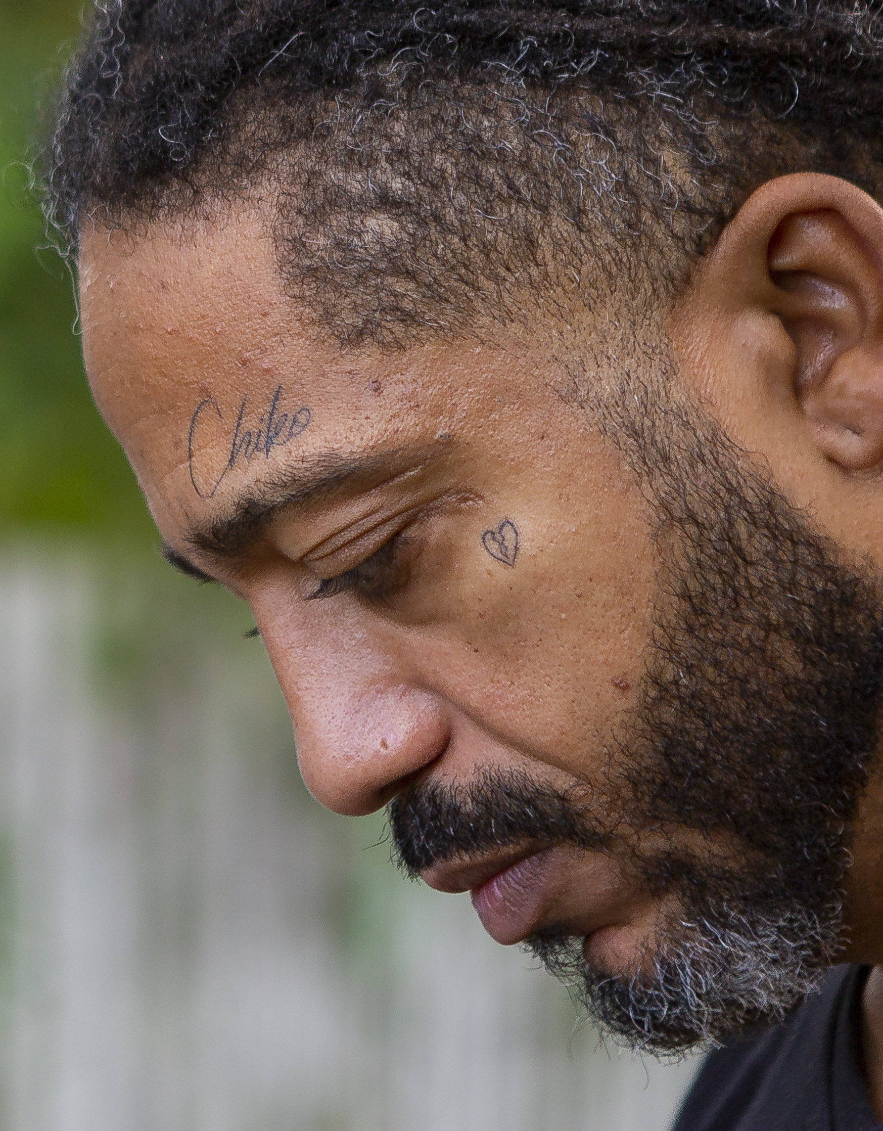 Free Rene Balbona, 39, a youth pastor, pauses for a moment in front of his home in Little Haiti on Saturday, January 19, 2019. Balbona's car and home were sprayed with bullets when his house got shot on November 28, 2018. Balbona's son, Isaiah, was killed on December 28, 2018 inside a car in Opa-locka.