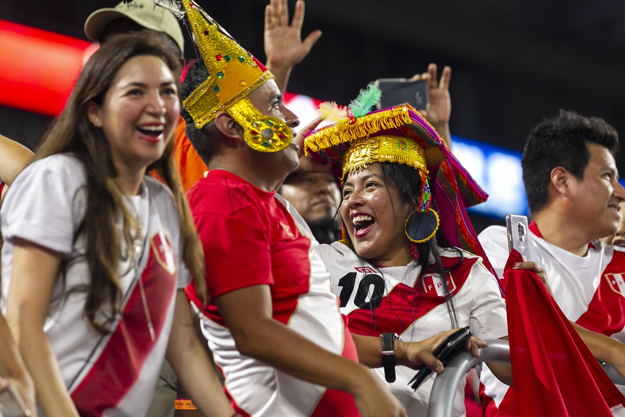 Fans celebrate before the start of a friendly soccer match between Peru and Chile at Hard Rock Stadium in Miami Gardens on Friday, Oct. 12, 2018.