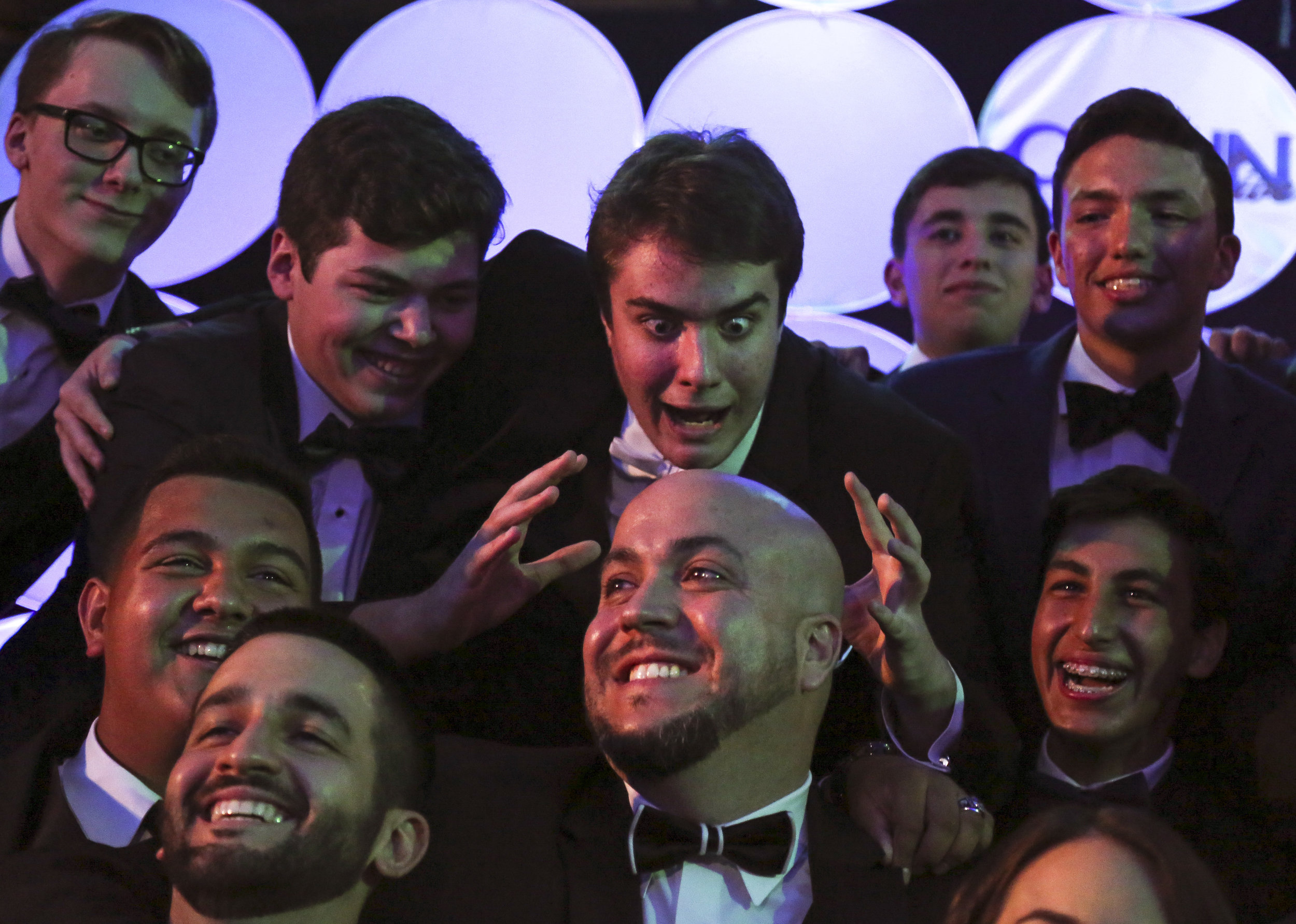 Phillip Bootsma, center top, makes a funny face while taking a group picture with CCNN live moderator Omar Delgado, center bottom, during the 3rd Annual Media Excellence Awards at Christopher Columbus High School on Saturday, April 16, 2016. The ceremony is presented by the Christopher Columbus News Network, which is run by high school students.