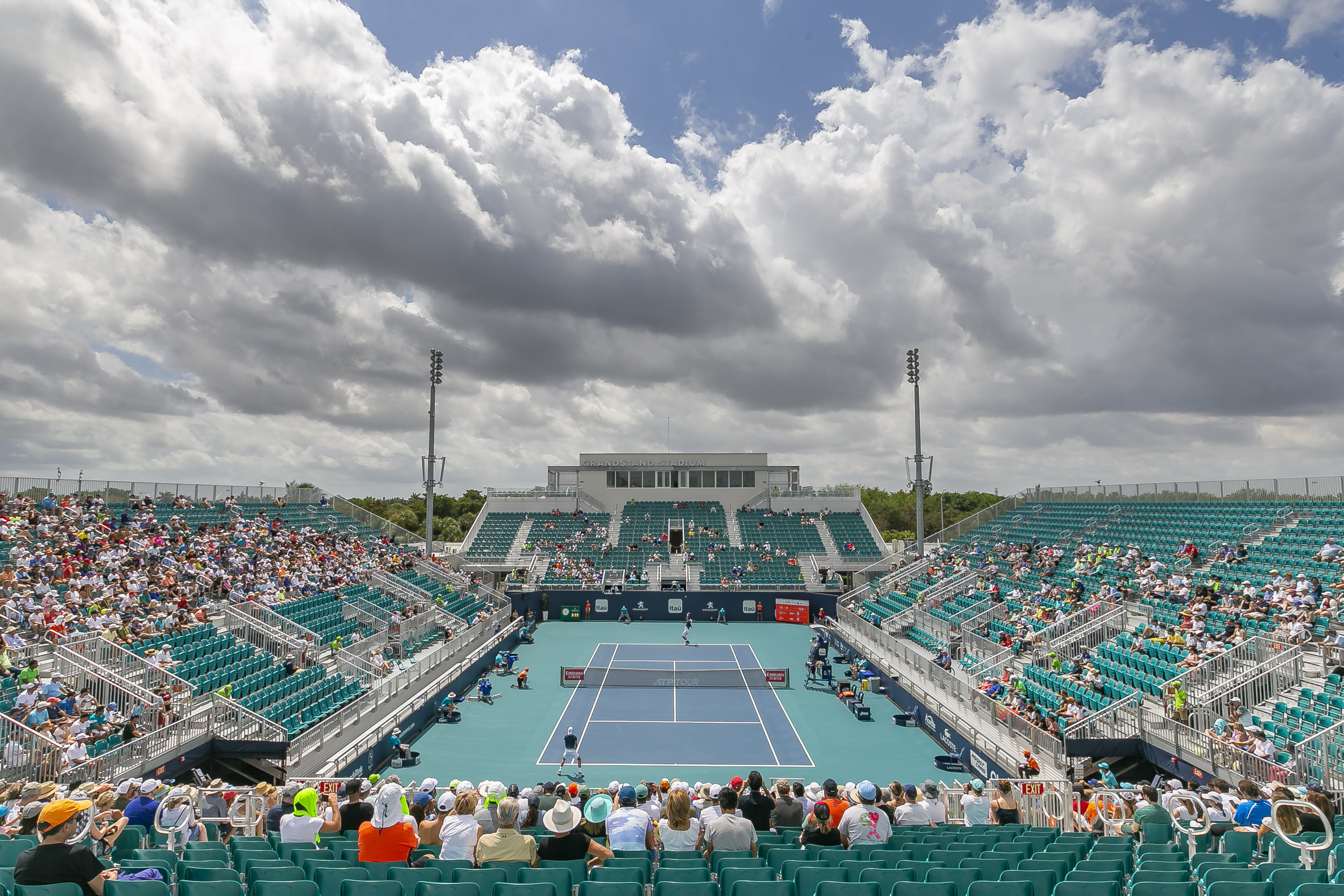 Attendees watch a match between Joao Sousa, of Portugal, and Kevin Anderson, of South Africa, during their match at the Miami Open tennis tournament on Monday, March 25, 2019 at Hard Rock Stadium in Miami Gardens.