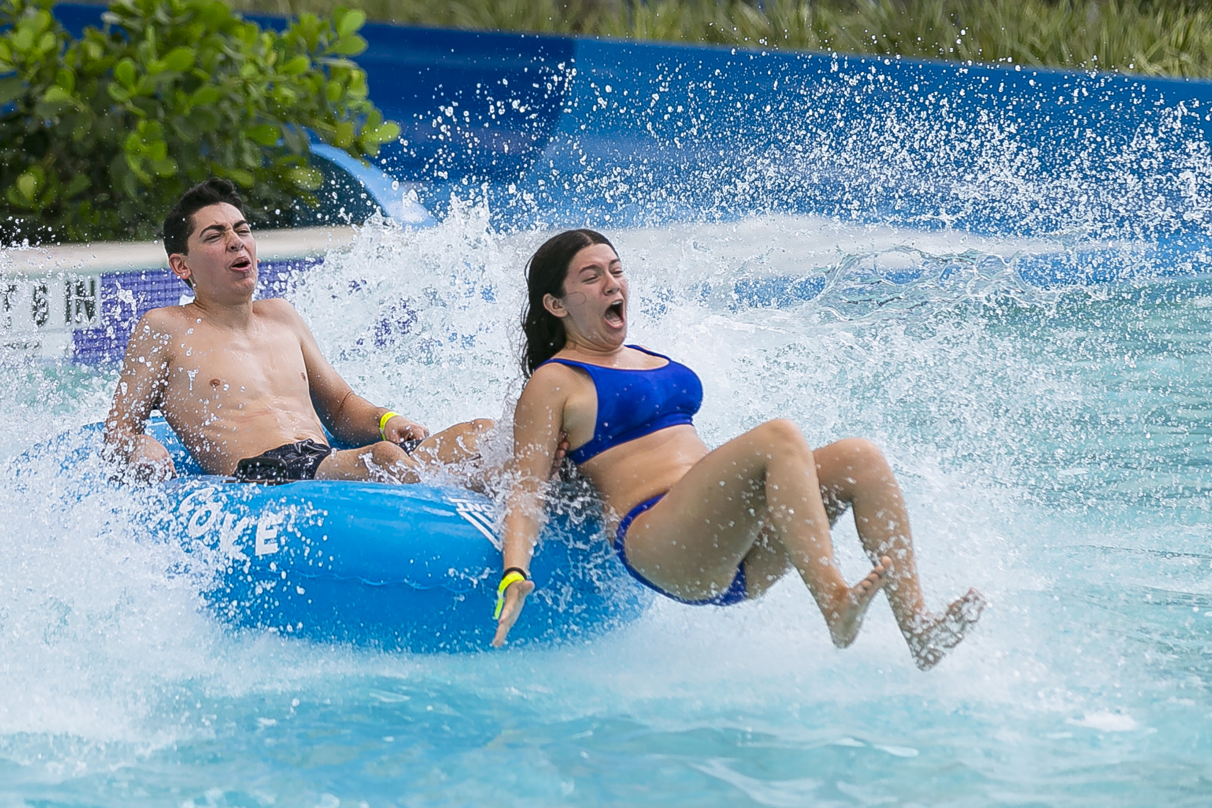 Brenda Martinez, 17, and her cousin, Jonathan Martinez, 17, go down a waterslide at Tidal Cove Waterpark in Aventura's JW Marriott Miami Turnberry Resort & Spa on Saturday, June 8, 2019. The park has seven water slides, a FlowRider surfing pool and a lazy river among other amenities.