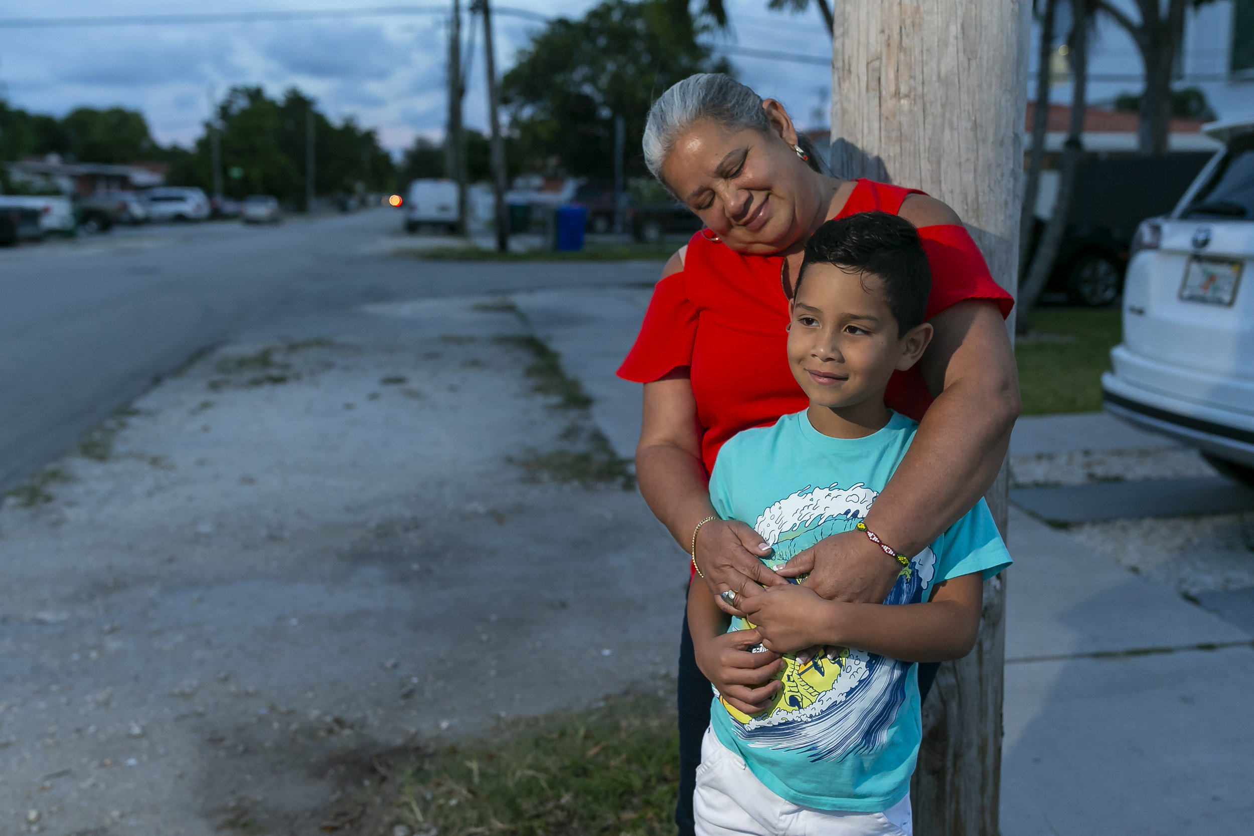 Maria Sanchez, 57, an employee at MIA Sky Chef, holds her grandson, Adonis King Sanchez, 7, outside of her home in Little Havana on Wednesday, June 5, 2019. Sanchez talked about her working conditions during an interview.
