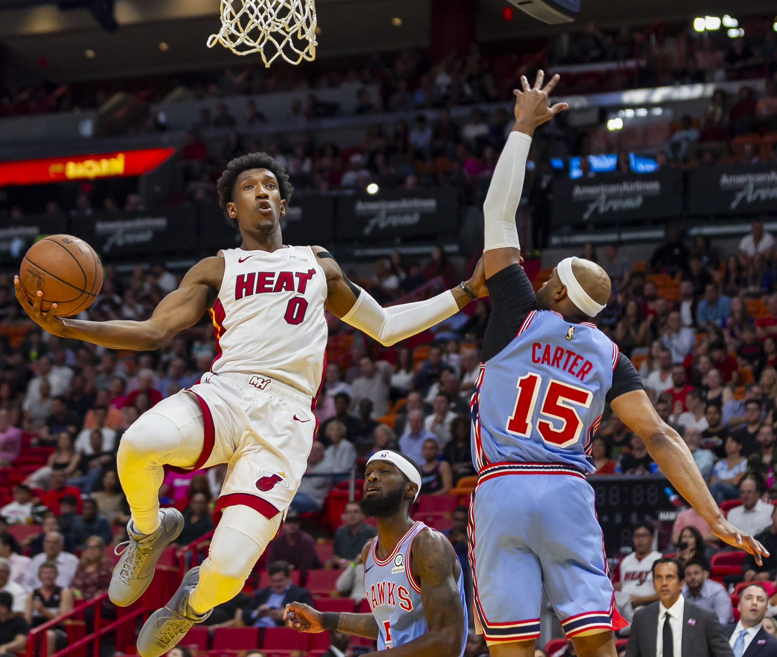 Miami Heat guard Josh Richardson (0) goes for an assist while Atlanta Hawks guard Vince Carter (15) tries to defend during the first quarter as the Miami Heat host the Atlanta Hawks at the AmericanAirlines Arena in downtown Miami on Monday, March 4, 2019.