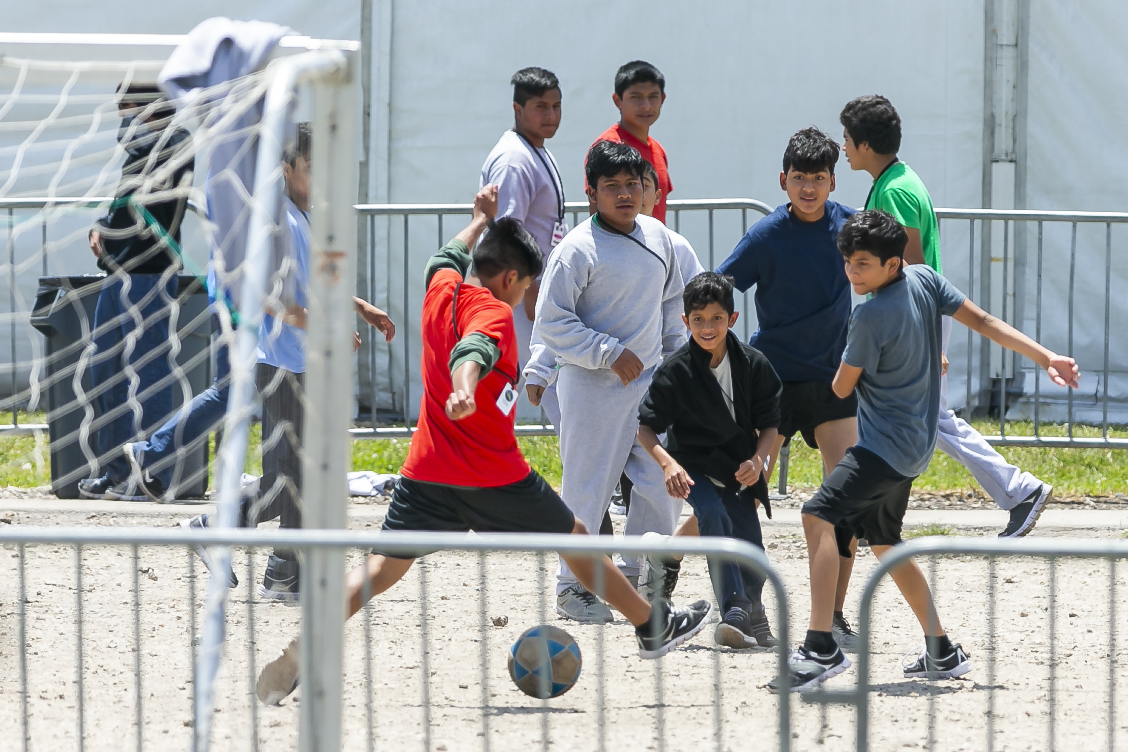 Migrant children play soccer inside the Homestead Temporary Shelter for Unaccompanied Children on Good Friday in Homestead, Florida on April 19, 2019.