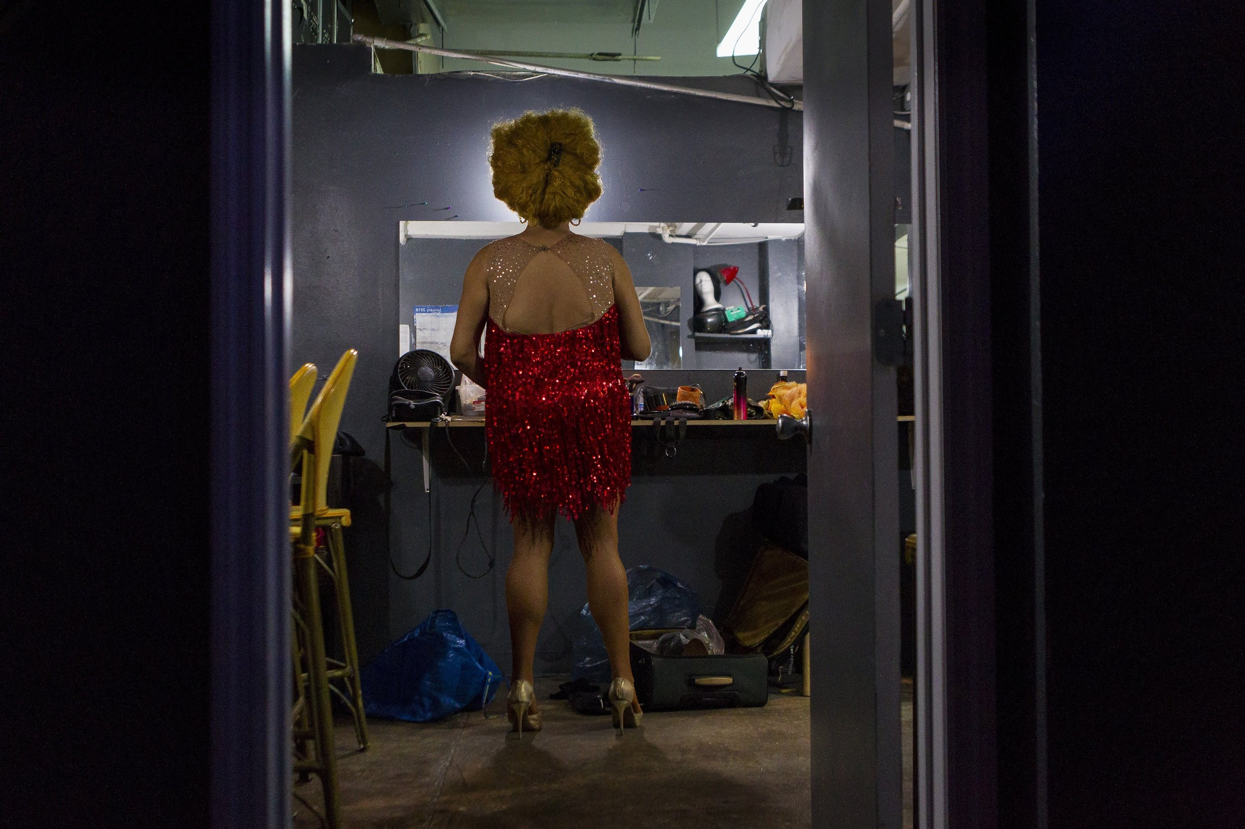 Noel Leon, 37, puts on clothes in a dressing room at the Palace Bar in Miami Beach on Wednesday, Jan. 31, 2018. Leon is an entertainer at the Palace.