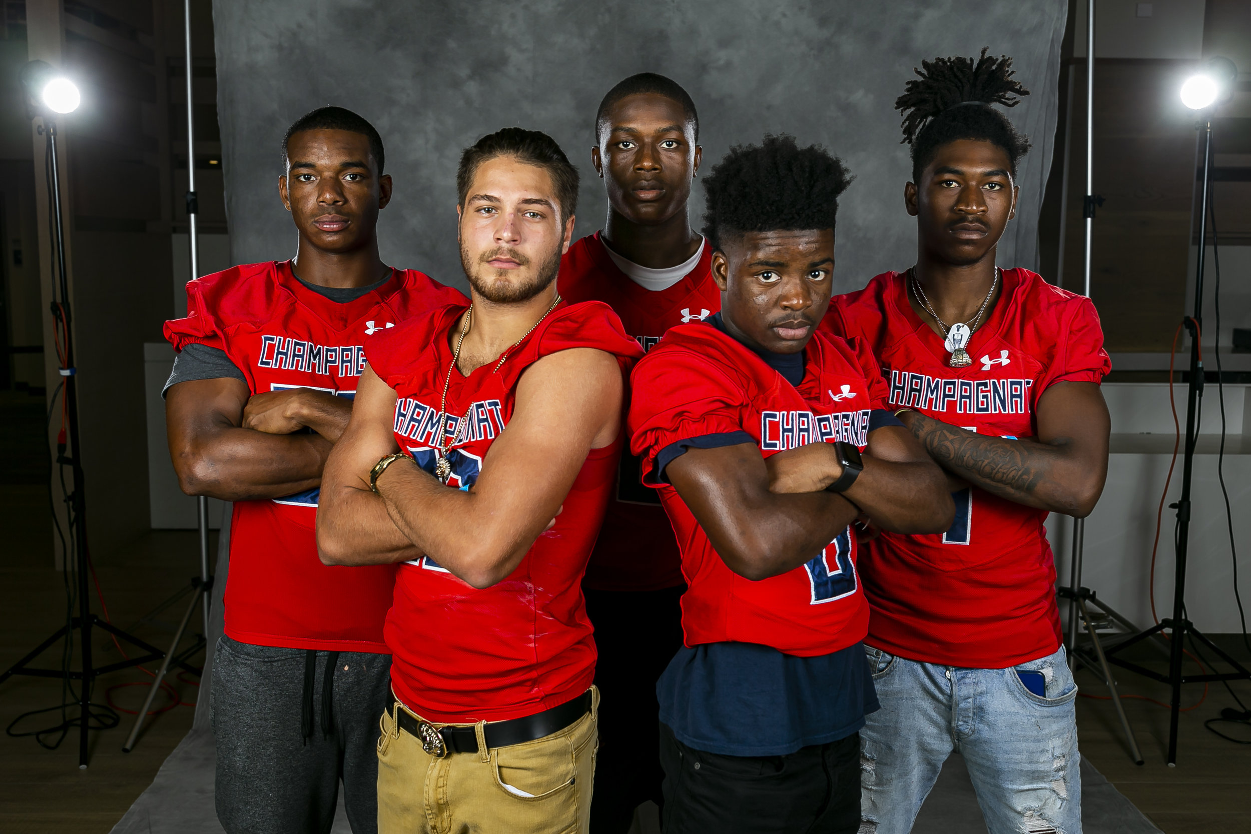 From left to right: Jesus Machado, Ryle Aguila, Jalen Harrell, Malik Rutherford and Johnquai Lewis from Champagnat Catholic High School, attend High School Football Media Day at the Hard Rock Stadium in Miami Gardens on Saturday, August 3, 2019.