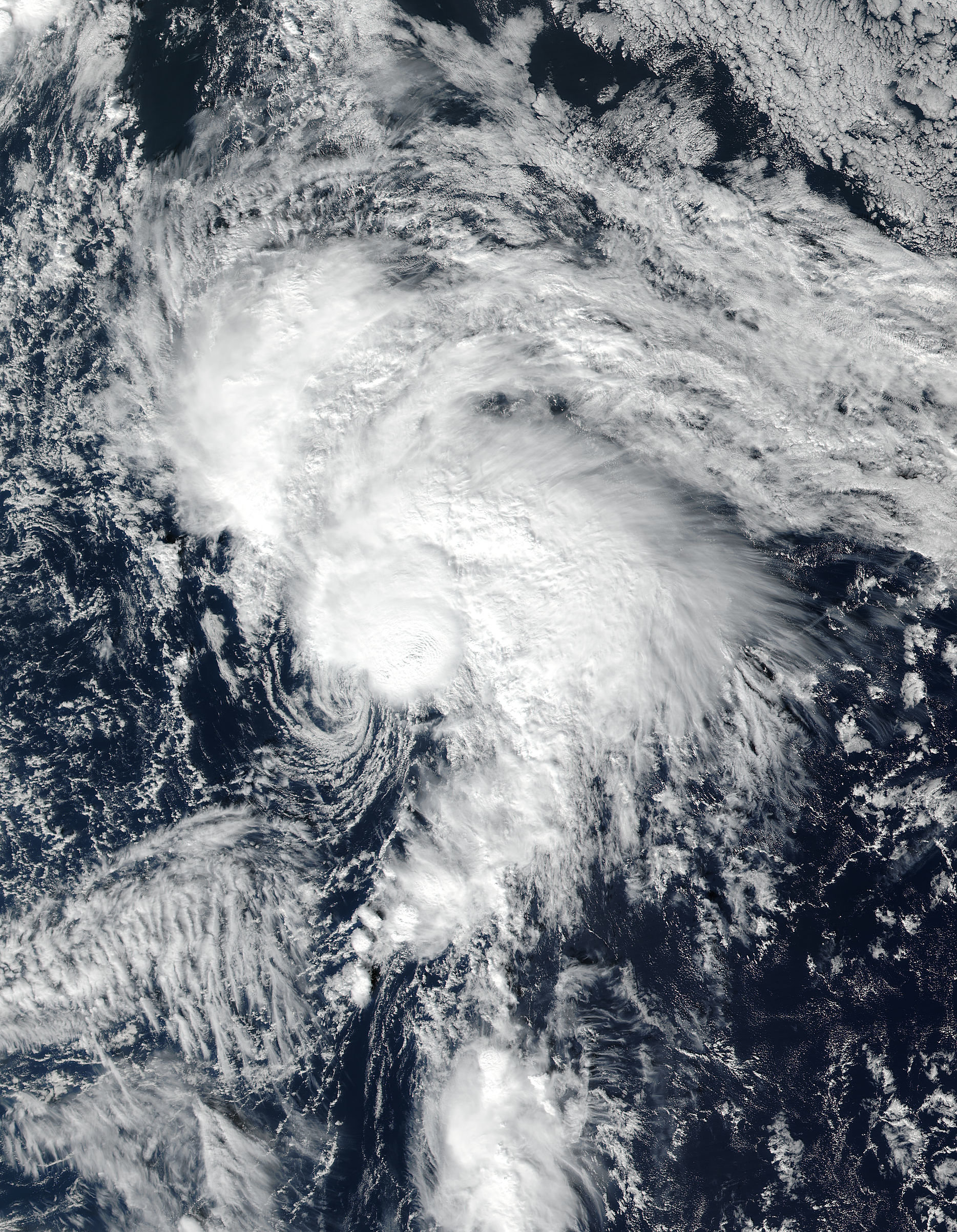 A magnified comma-shaped cloud that is a common sign for a cyclone or other violent weather storm