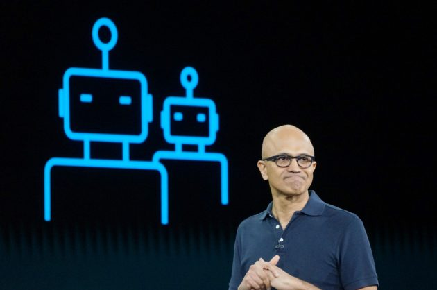 "CEO of Microsoft, Satya Nadella, pictured at the company's Build developer conference, says the company's collaboration with OpenAI will help to democratize artificial intelligence while keeping safety as a key value, aiming to ensure ""that the robots stay on our side"". (GeekWire Photo / Todd Bishop)"