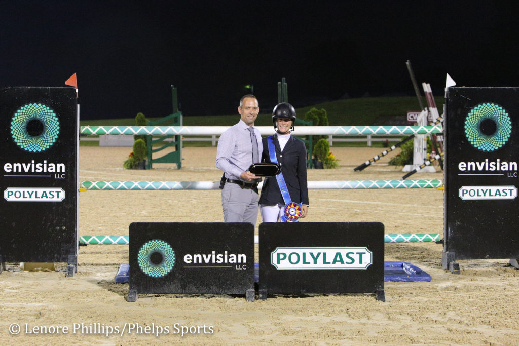 Sydney Shulman receives the Leading Rider Award from Brian Lookabill.