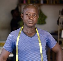 Emmanuel is our main tailor in Ghana. He cuts all the garments, and supervises his team of tailors & apprentices.