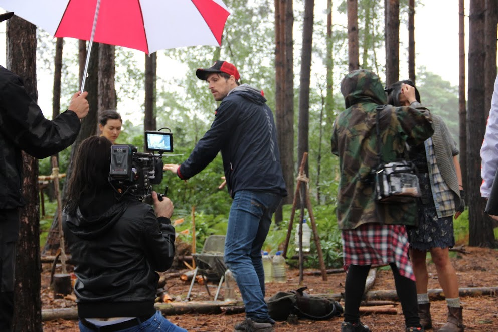 Giles Alderson blocking through the shot on set of The Heart of the Forest with DoP Andrew Rodger whilst actors Lourdes Faberes and Jessica Henwick prepare for the take