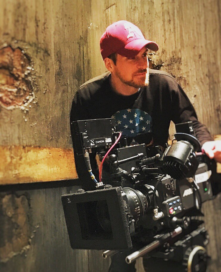 Giles Alderson on set on camera directing pic.jpg