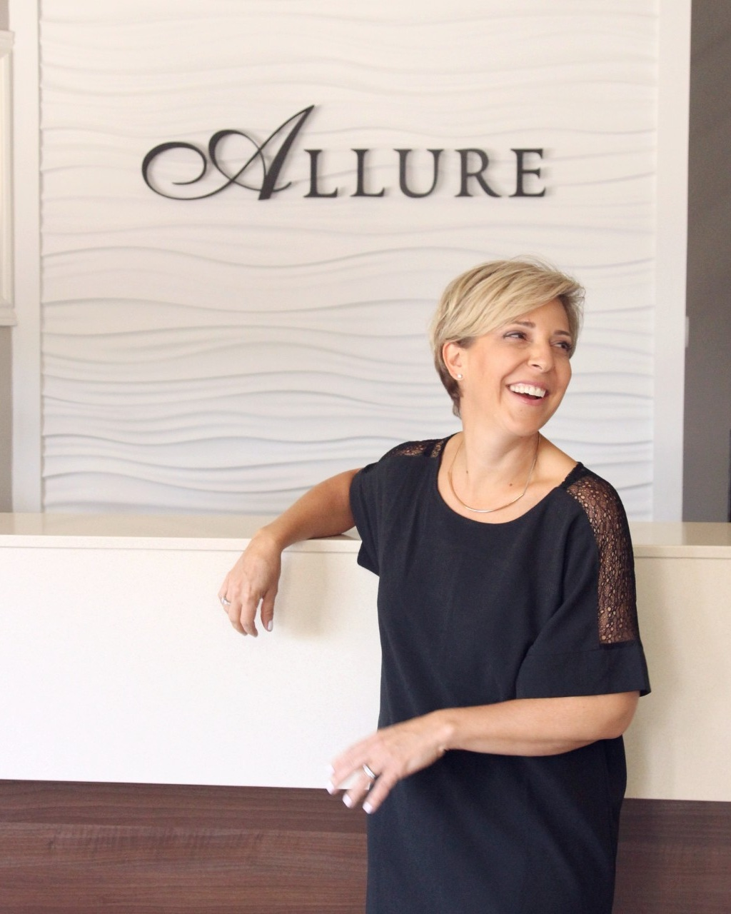 Paola Agostini - Meet Paola, our not so big boss lady! 17 years ago Paola, and her family decided to build a brand with a focus on luxury, quality, and sophistication. The Agostini's took one of Manotick's heritage buildings, and transformed it into a house of style. Allure is a labour of love for Paola, and her commitment to providing the best in staff, service, and atmosphere never falters.