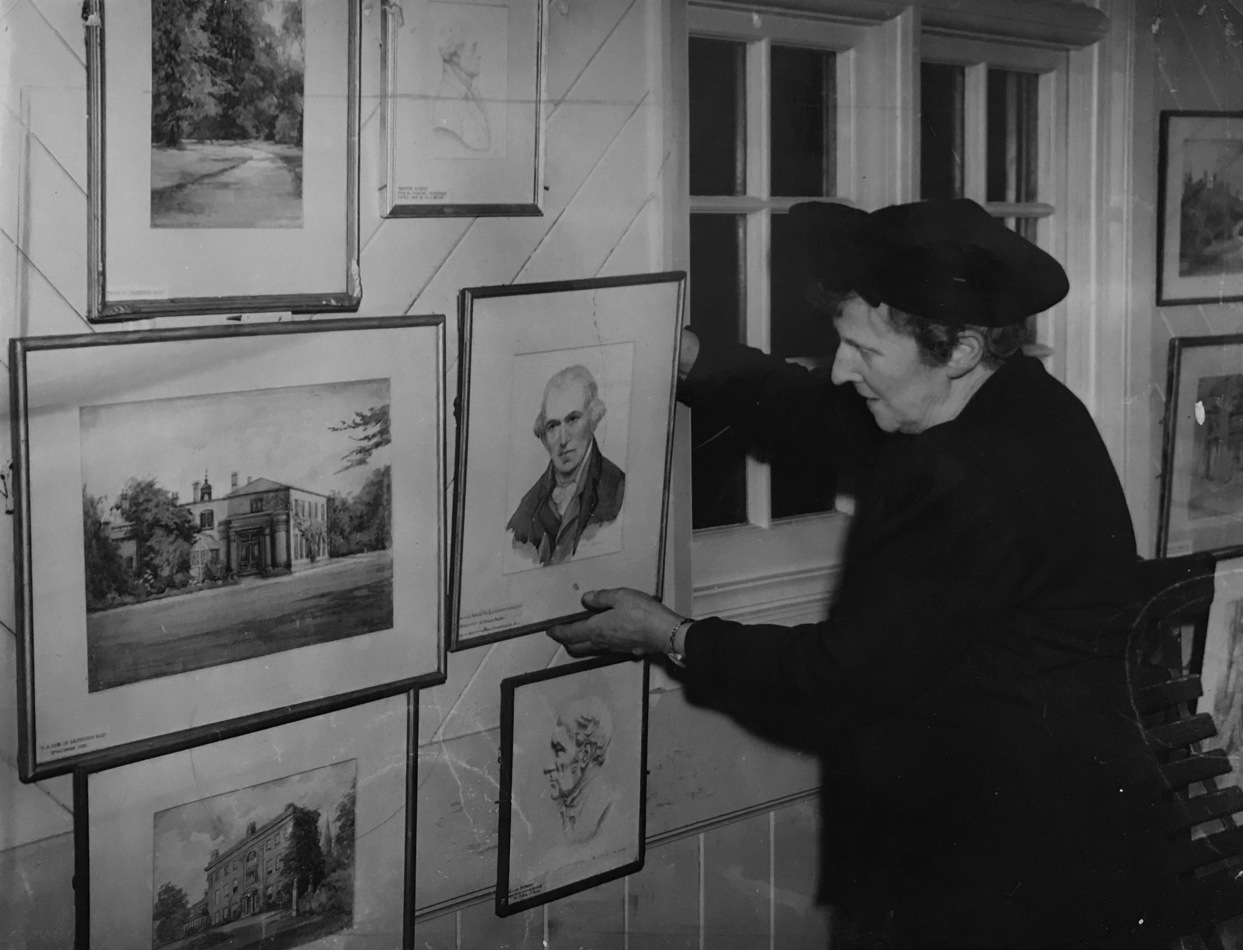 MRS BULLOCK HANGING PICTURES IN THE SONS OF REST BUILDING