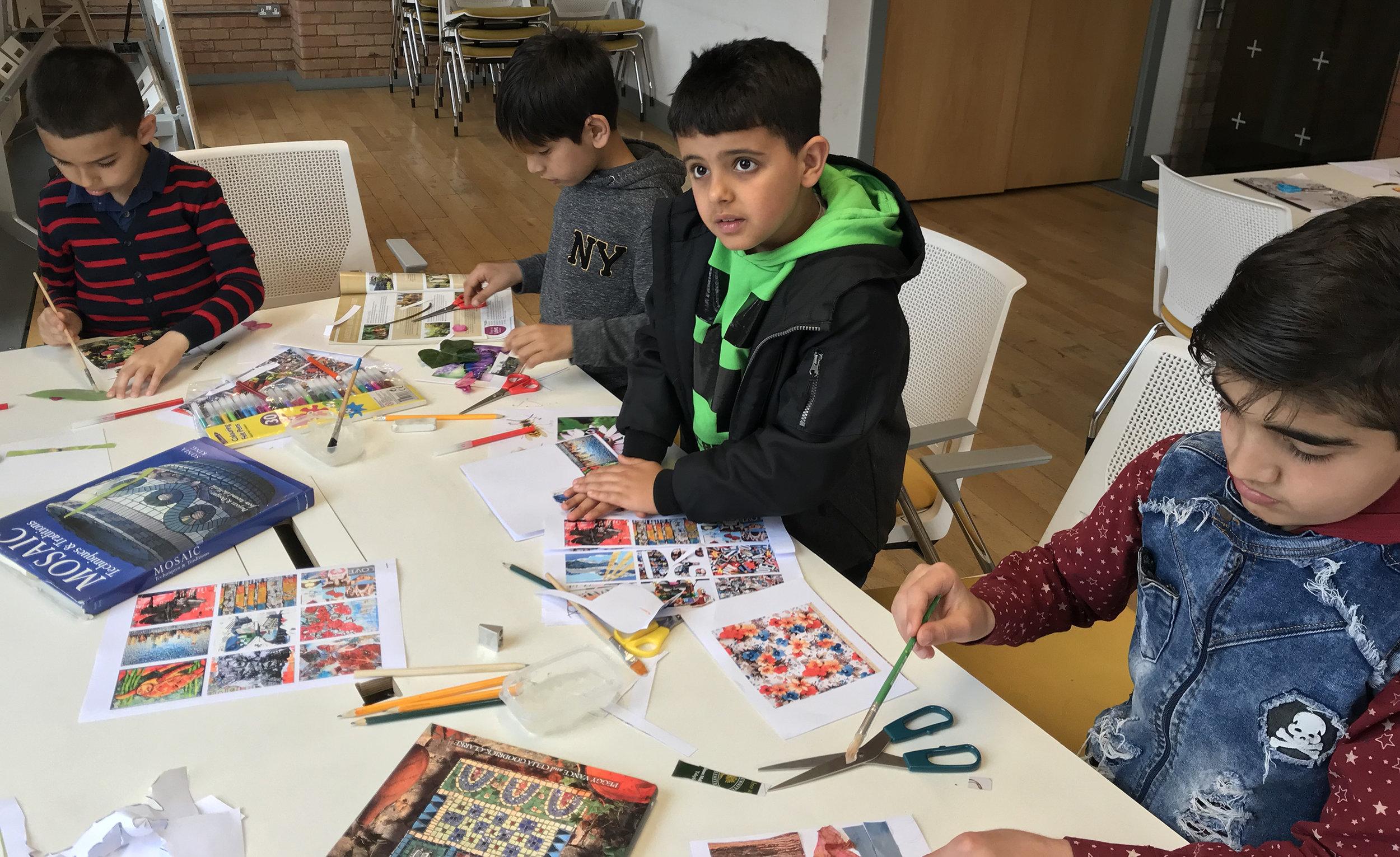 Children taking part in the Amal Project Art Workshop at the Birmingham City Council Activity Day for Syrian Refugees on 15th June 2019.