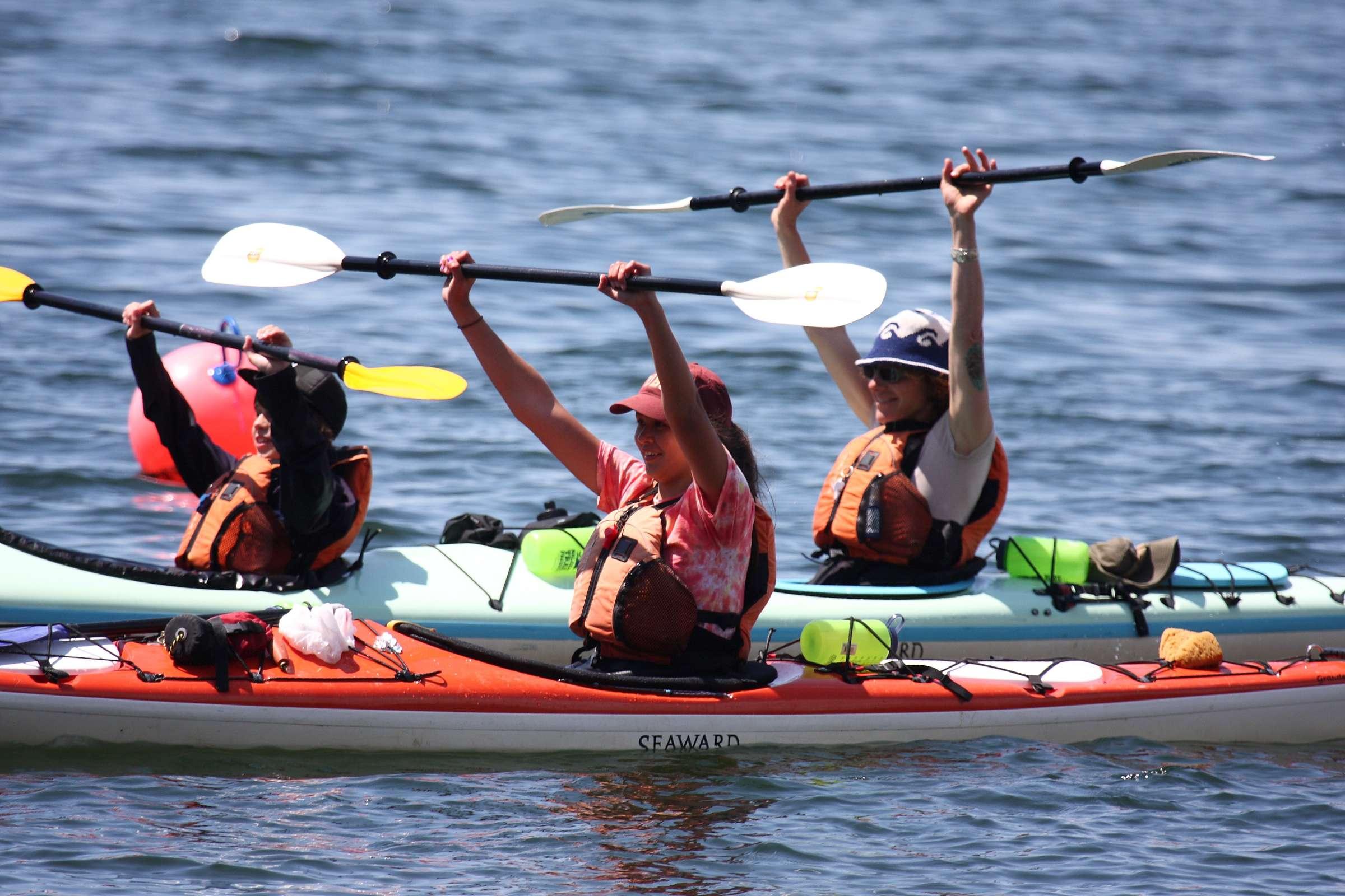 Kayakers w Paddles Up.jpg