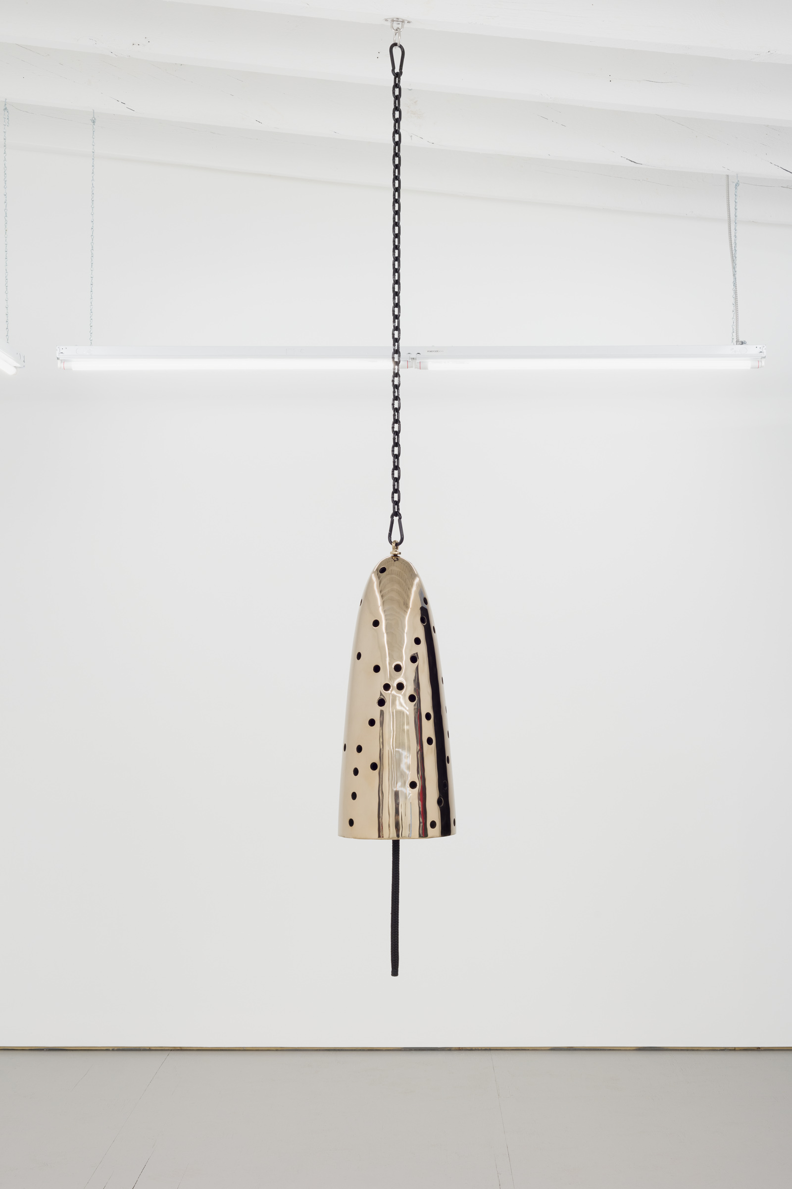 Davina Semo   Siren , 2019 Polished and patinated cast bronze bell, whipped nylon line, wooden clapper, powder-coated chain, hardware Bell: 32 in. tall x 13 in. diameter
