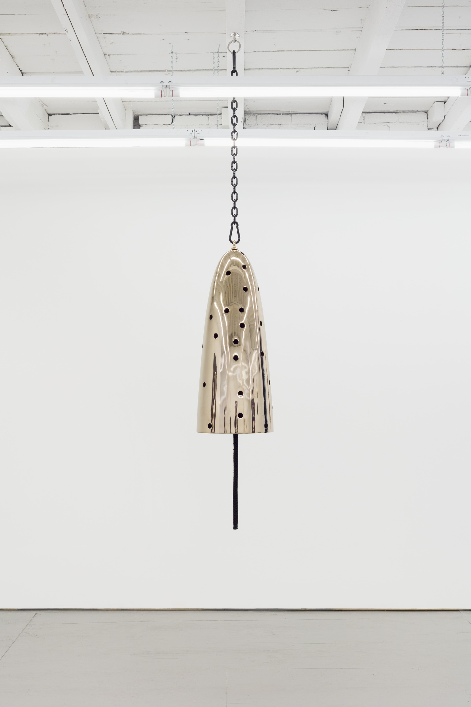 Davina Semo   Conductor , 2019 Polished and patinated cast bronze bell, whipped nylon line, wooden clapper, powder-coated chain, hardware Bell: 32 in. tall x 13 in. diameter