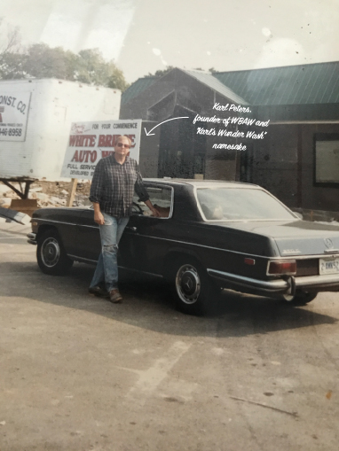 "Karl Peters, founder of White Bridge Auto Wash and inventor of ""Karl's Wunder Wash,"" in front of the car wash under construction in 1987."