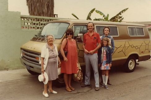 The Feynman family next to Feynman's famous van that holds drawings explaining his QED theory called the Feynman diagrams.