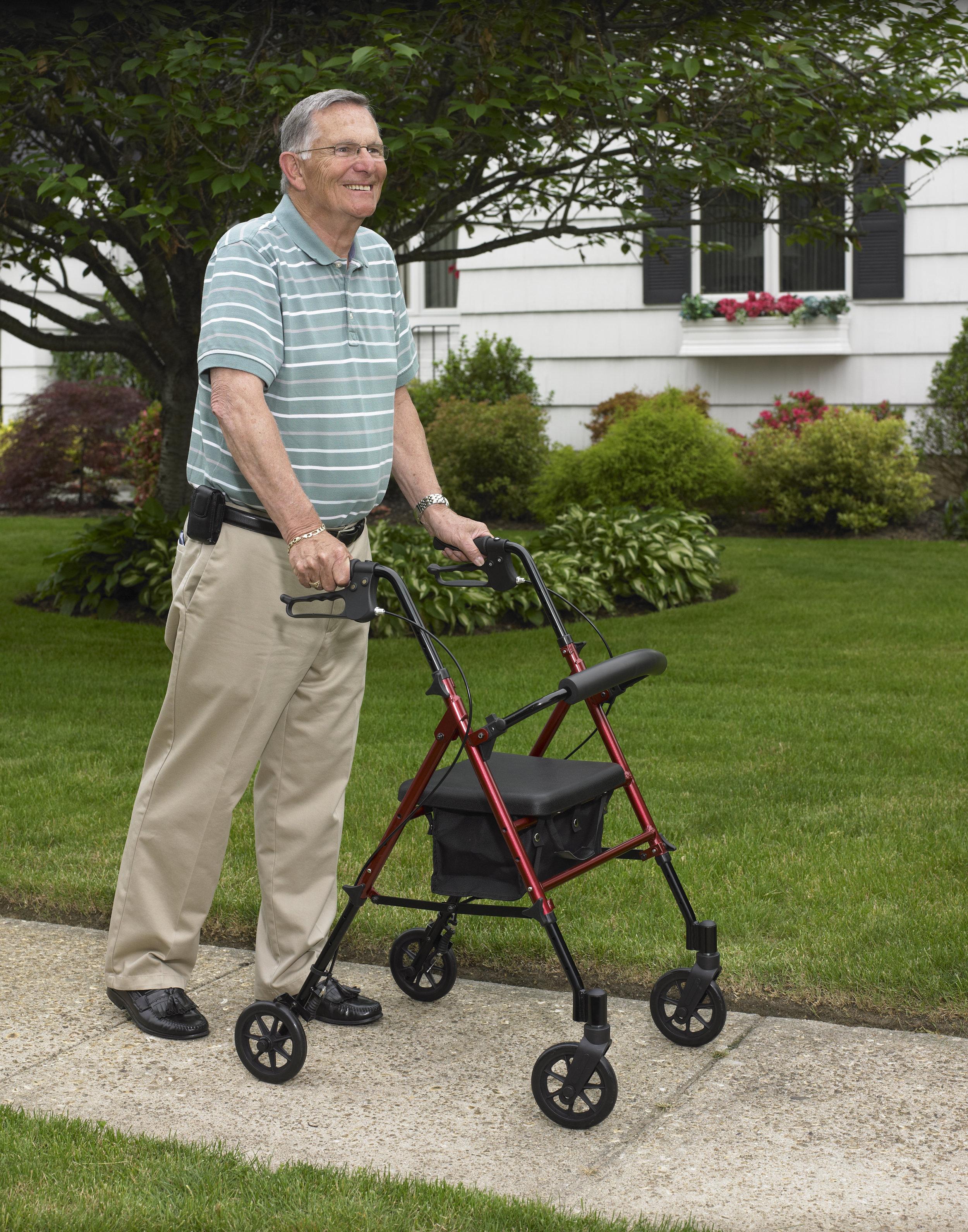 old-man-using-wheeled-walker-outdoors.jpg