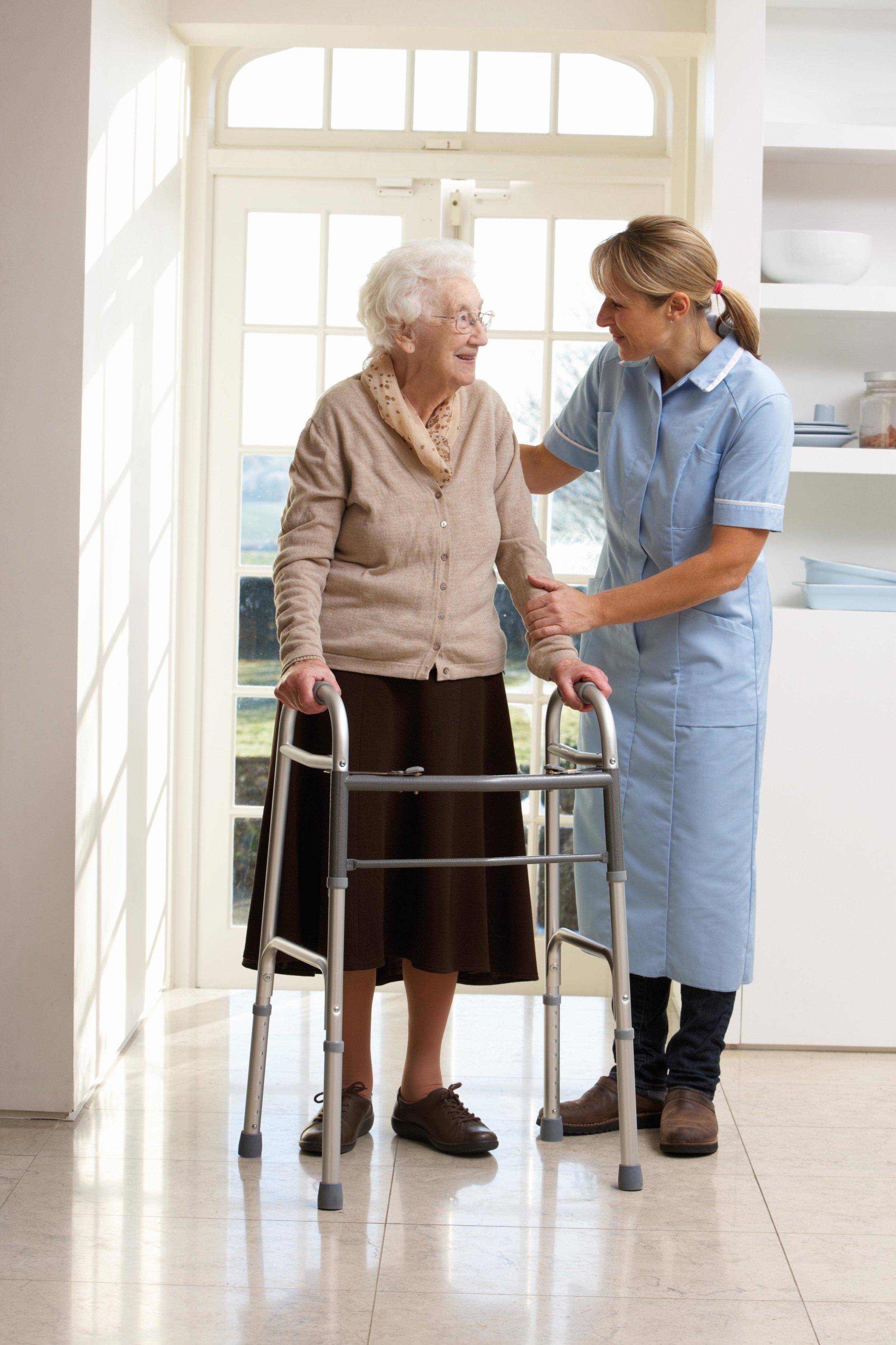 carer-with-elderly-lady-walking-aids.jpg