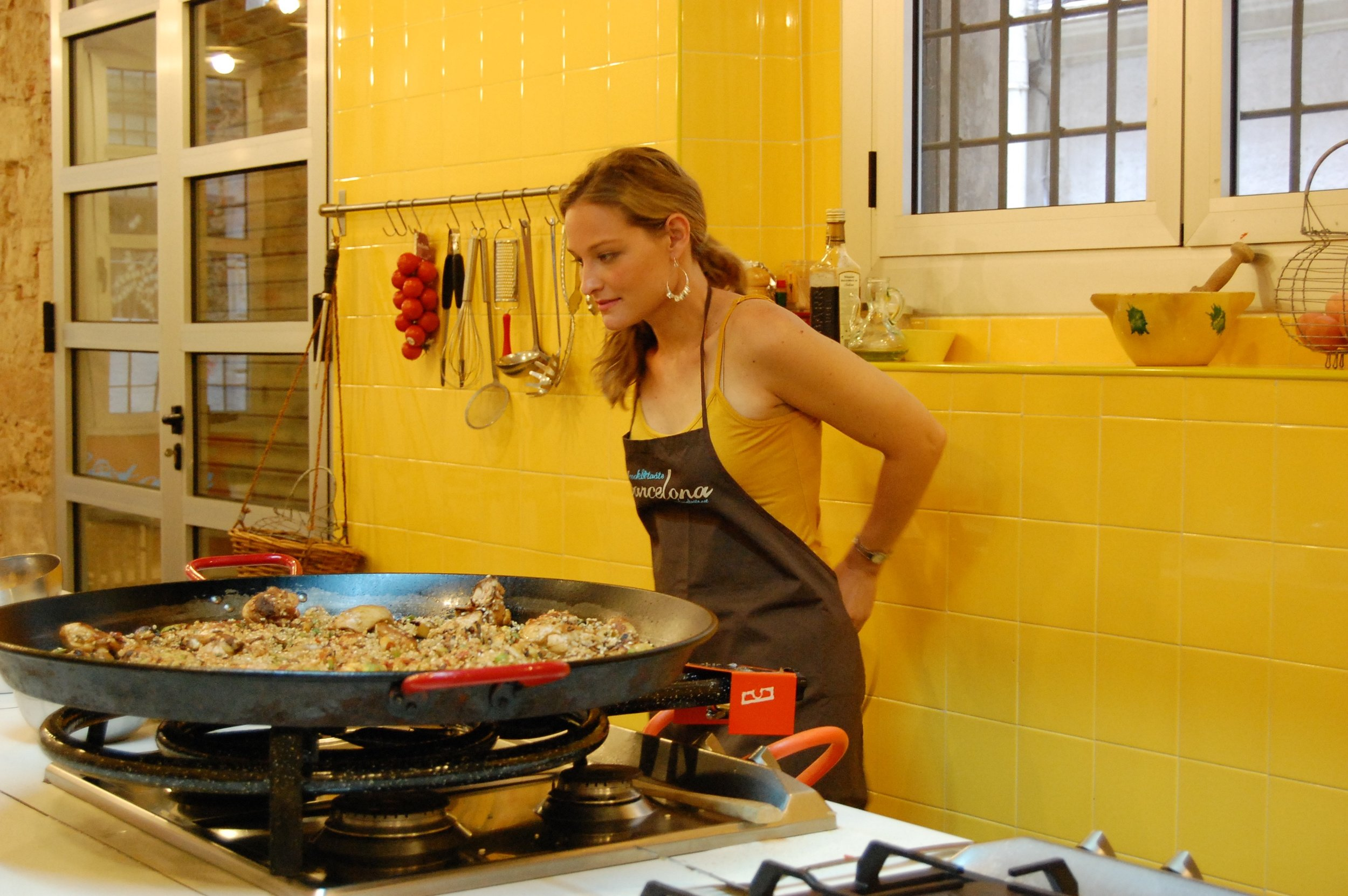 Me, in a cooking class in Barcelona. Ready to take a nose-dive into a giant pan of paella. I hadn't planned to match their yellow tile wall, but I love the fact that it almost makes me look naked under that apron. I get crazy on vacation.