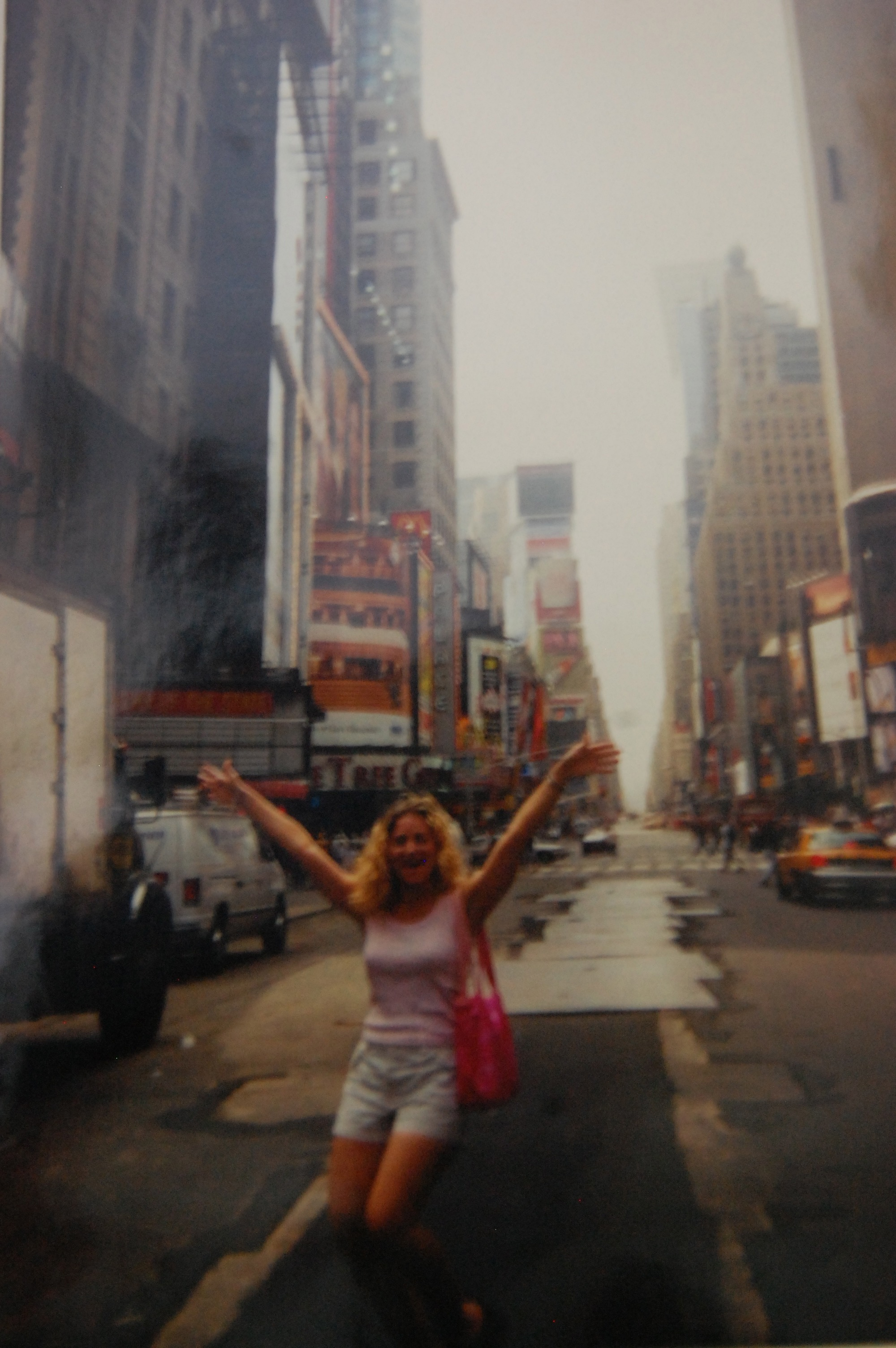 Me in Times Square, 1999, the last time I wore shorts. If my boobs looked like that right now I'd throw a parade in their honor.