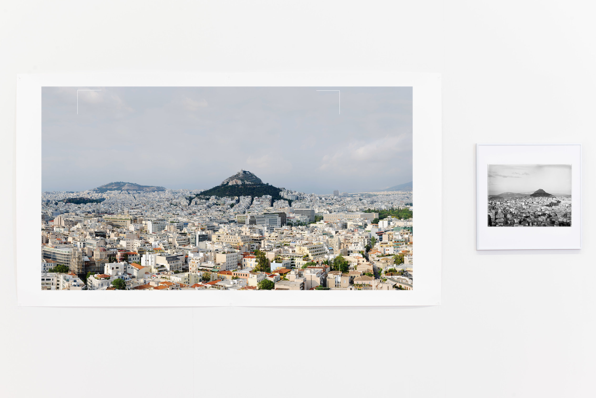 """L - Rowan Conroy,  View of central Athens from the Acropolis. 5:46 pm, 5 June 2010, 7˚58""""19 N 23˚43'39"""" E,  2010, pigment inkjet print on cotton rag paper, 110x195cm. R - William John Woodhouse, NM2007.55.7,  View of Central Athens and Lycabettus, looking north,  c.1908. Carbon Piezo print on cotton rag, 29.4x38.4cm. Reprinted 2011 from scan of original glass plate negative (16.5x21.6cm). Copyright Nicholson Museum, The University of Sydney."""