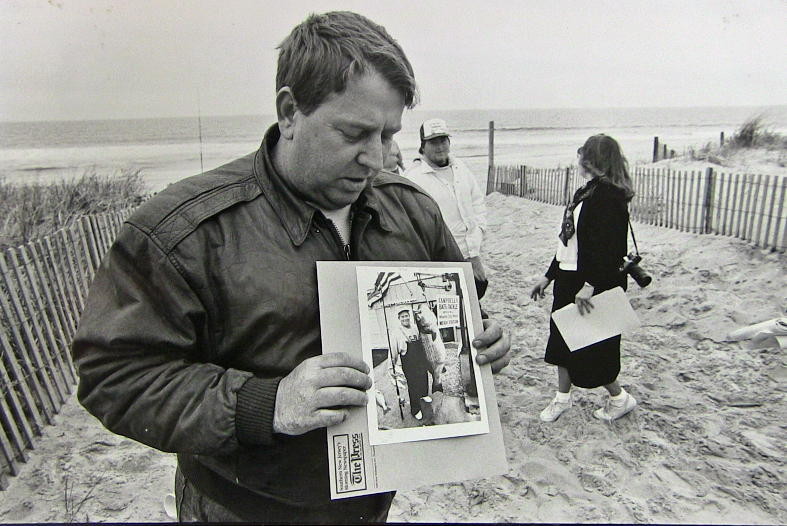 Al McRenolds - the one time striped bass record holder at 78lb 8oz (Caught in Atlantic city off the surf/jetty ON a Plug), Al Mcreynolds visited the LBI surf for a press event. Here in the phot Al is holding the photo of his weighin at Campbell's Bait & Tackle… Sept 21, 1982