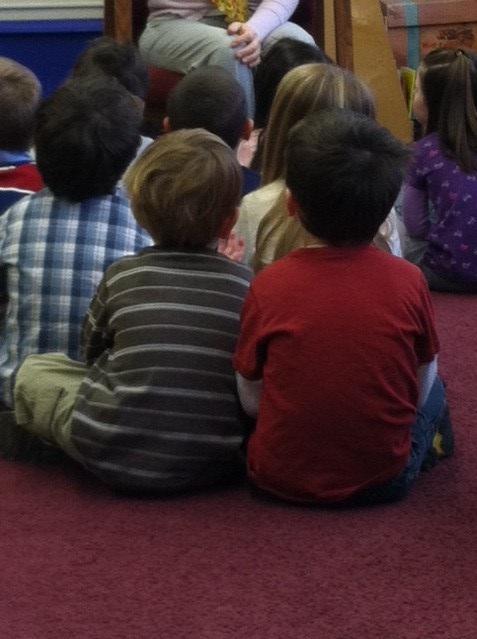 boys sitting looking at teacher