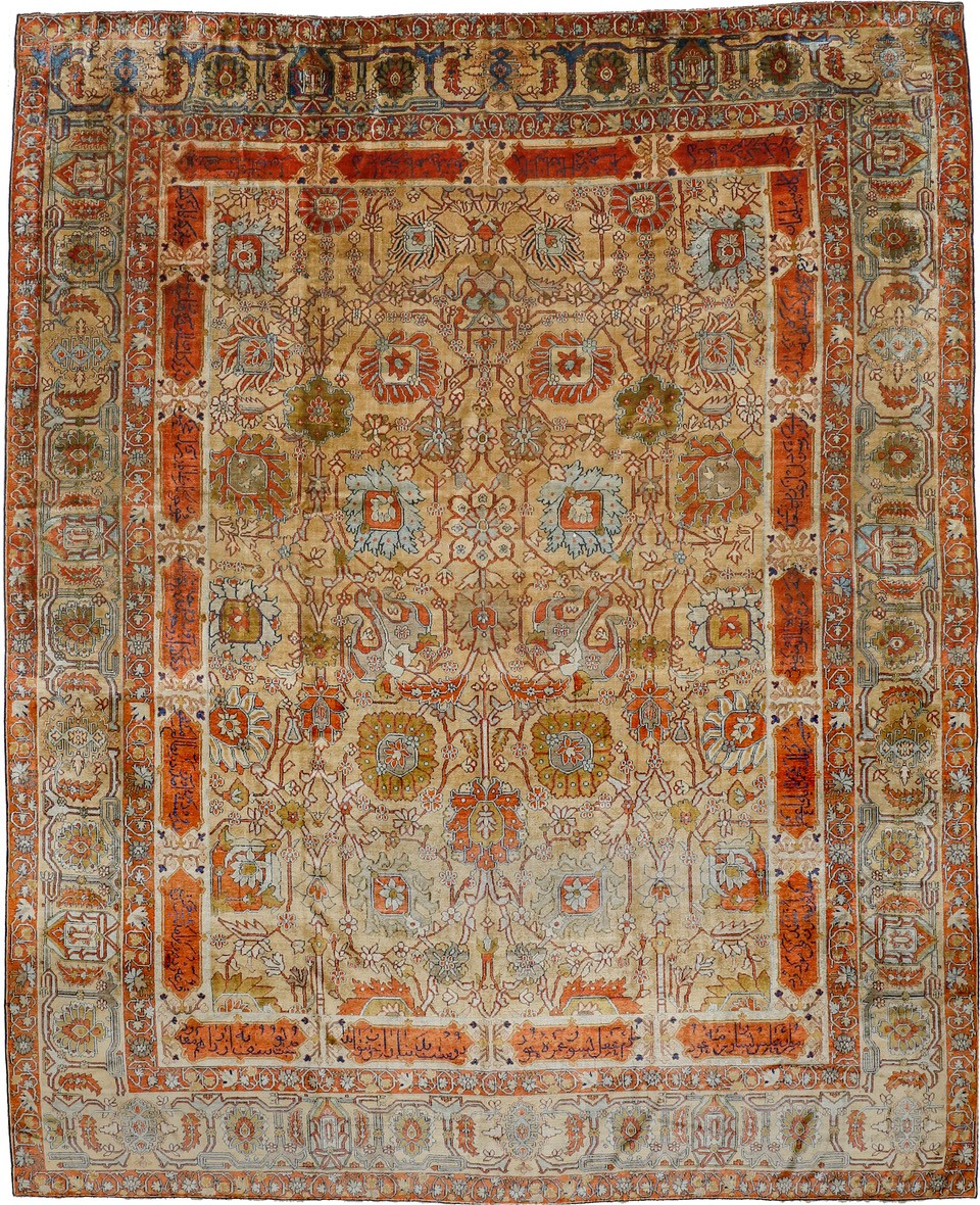 Rug with scrolling palmettes and inscribed cartouches