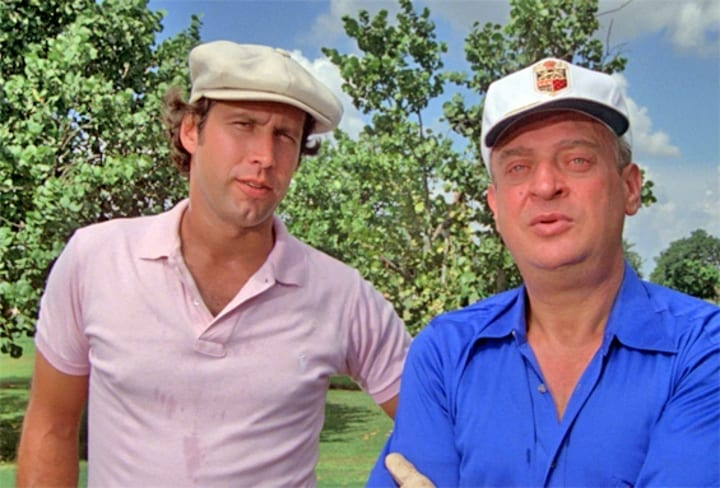 bushwood elite - Louie Divots (Little Falls, NJ) & Cousin Eddie (Wayne, NJ)Give me half a dozen of the Vulcan D-tens......and set my friend up with the whole schmear.You know, clubs, bags, shoes...gloves, shirt, pants.Orange balls! I'll have a box of those...and give me a box of those naked-lady tees. This is the worst-looking hat I ever saw! You buy a hat like this, I'll bet you get a free bowl of soup...It looks good on you, though.