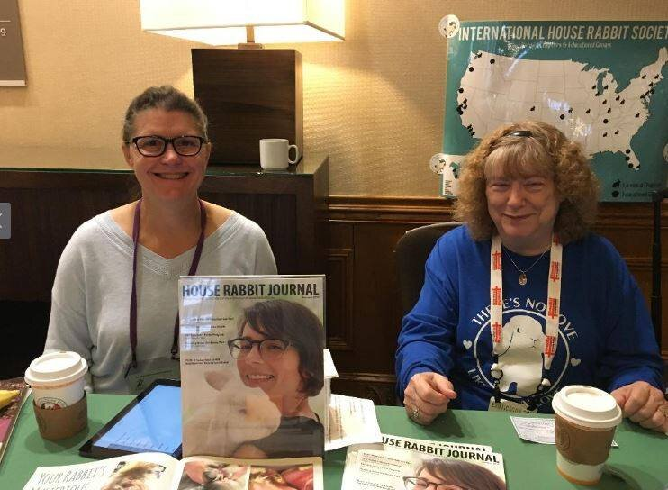 Dawn Sailer and Joy Gioia sit at the House Rabbit Society booth