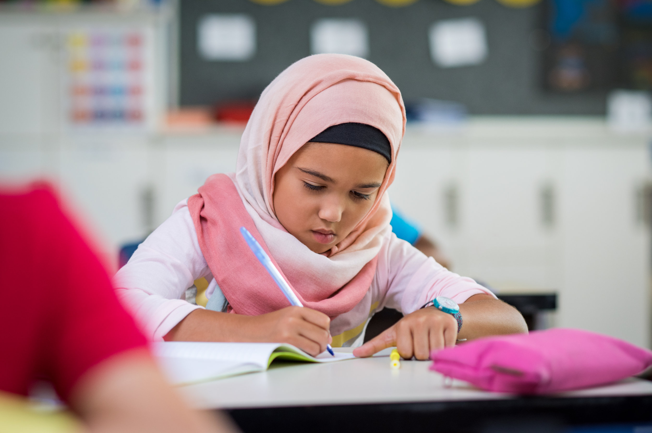 young-girl-wearing-hijab-studying-PZ9S7WR.jpg
