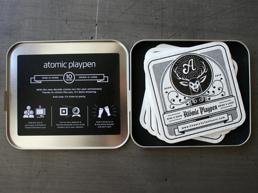 0001_atomic_playpen_coasters_metal_case_inside.jpg