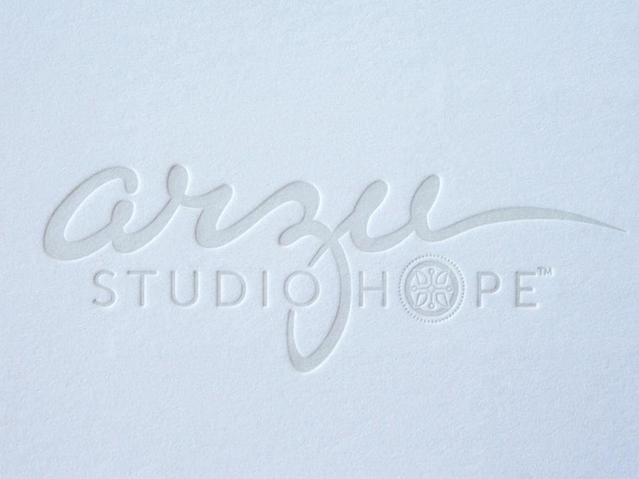 0004_Arzu__letterpress_white_logo.jpg