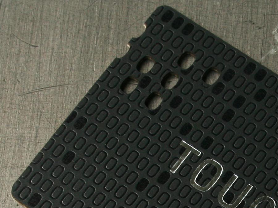 0001_Touchpoint_business_cards_letterpress_lasercut_detail.jpg