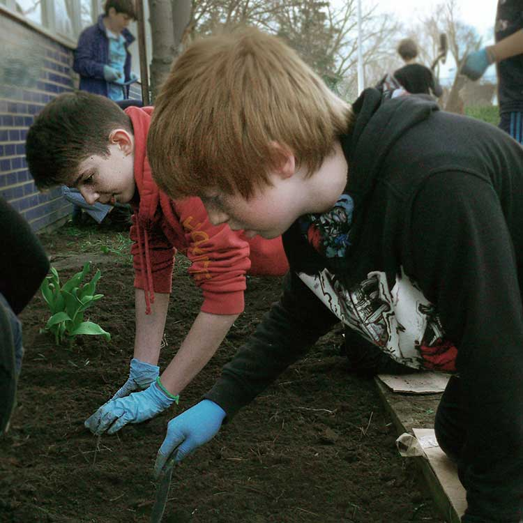xocial_earth-day-planting-teens.jpg