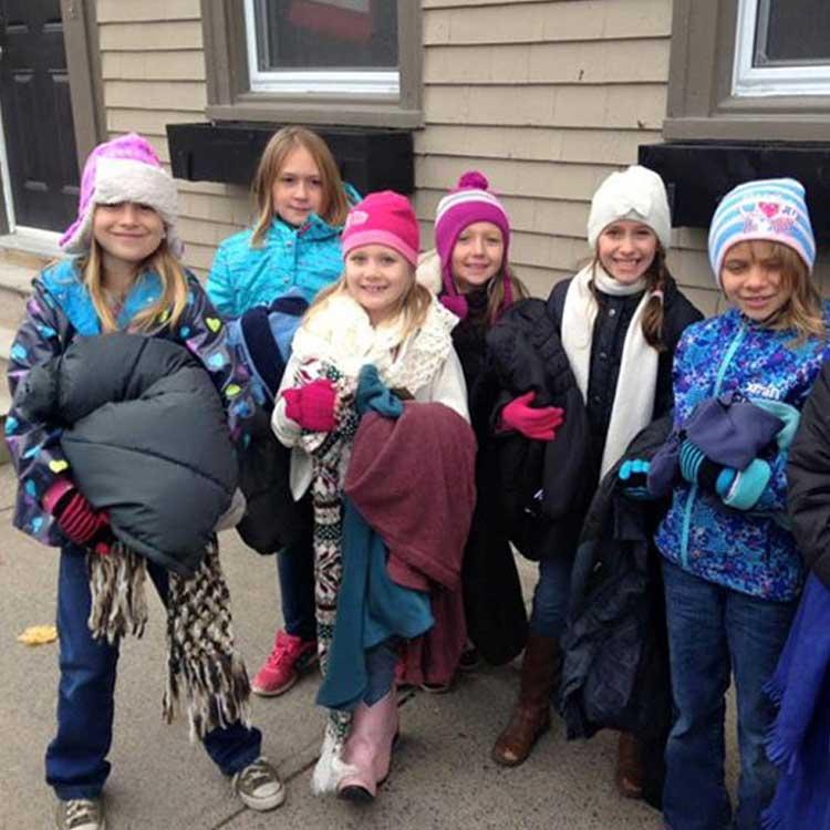 xocial_kids-donating-coats.jpg