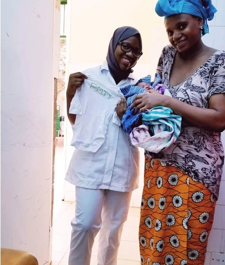 WHO WILL GET YOUR DONATIONS?  Giving FMTY onesies that were donated from the University of St. Thomas to mothers before they were discharged from the hospital. Many women will come to the hospital for labor without clothing for the child and will leave with nothing but a cloth of fabric she brought from home. Donations like gently-used clothing, hygiene products (e.g. pads, baby diapers, wipes), and anything essential for the mother and baby are needed.