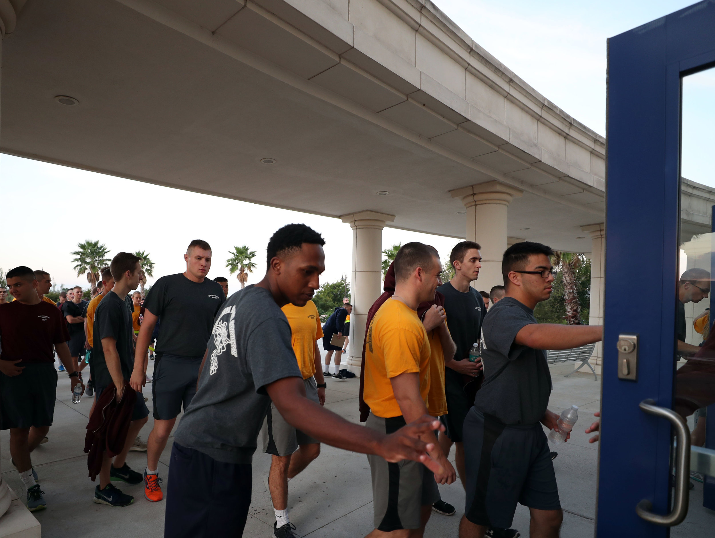 Cadets walk into their dorm, Texas A&M Maritime Academy Hall, after an early morning work out on Wednesday, Nov. 15, 2017. Living in a shared space allows the cadets to truly get to know one another, study together, build camaraderie and have a set schedule.
