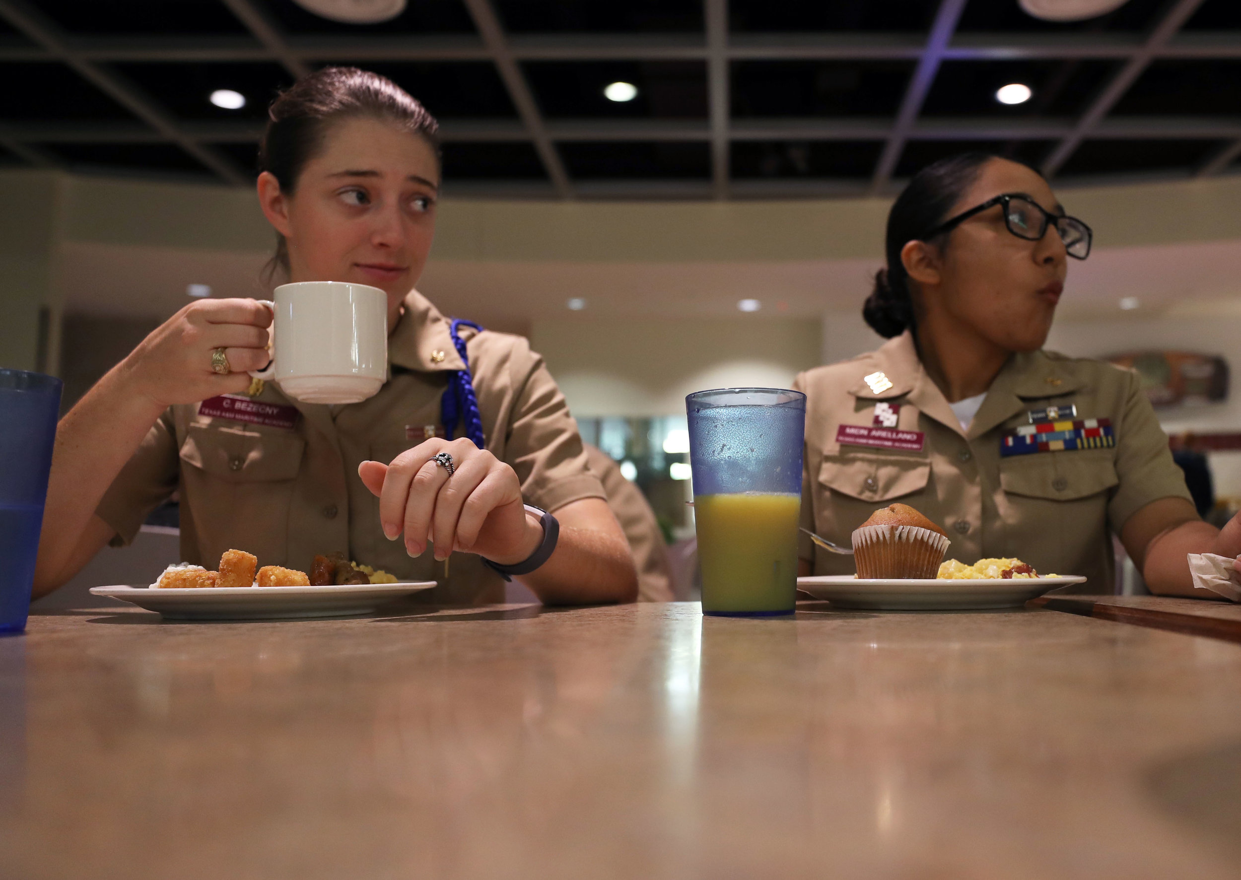 "Chief of Staff Caitlin Bezecny and Cadet Rose Arellano eat breakfast together at a dining hall on Wednesday, Nov. 15, 2017. Bezecny and Arellano met in the corps of cadets and have thrived in their leadership positions. According to Bezecny, a good GPA and a willingness to work hard are all one needs to have a leadership position. ""Everyone has a chance, but it's up to you to pursue those positions."""