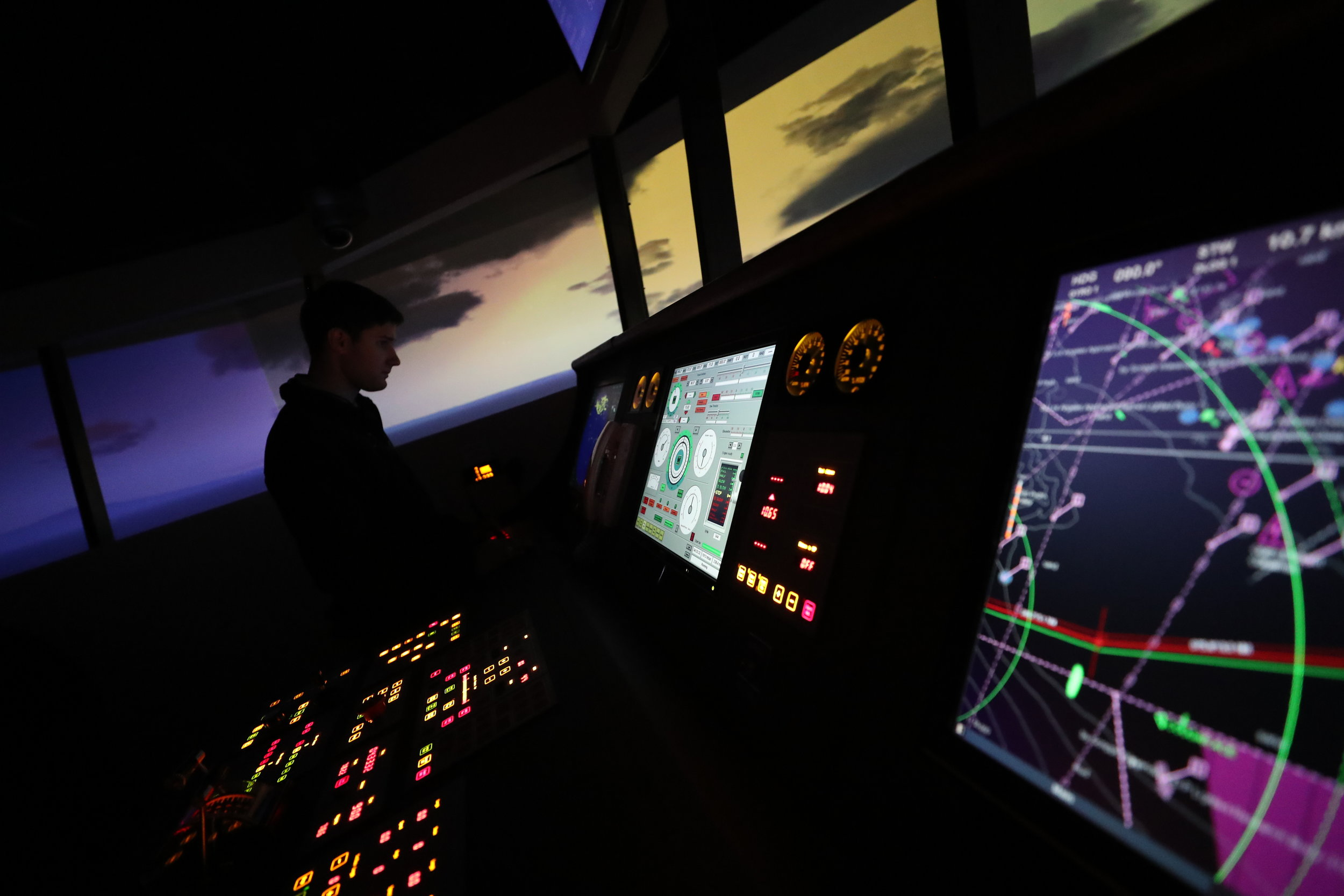 Tyler Mire looks at their ship's position while using the simulator on Wednesday, Nov. 29, 2017. With hands-on classes, mandatory time on the TS General Rudder and experience on three cruises, the cadets in the Maritime Academy are highly trained professionals in the maritime industry when they graduate.