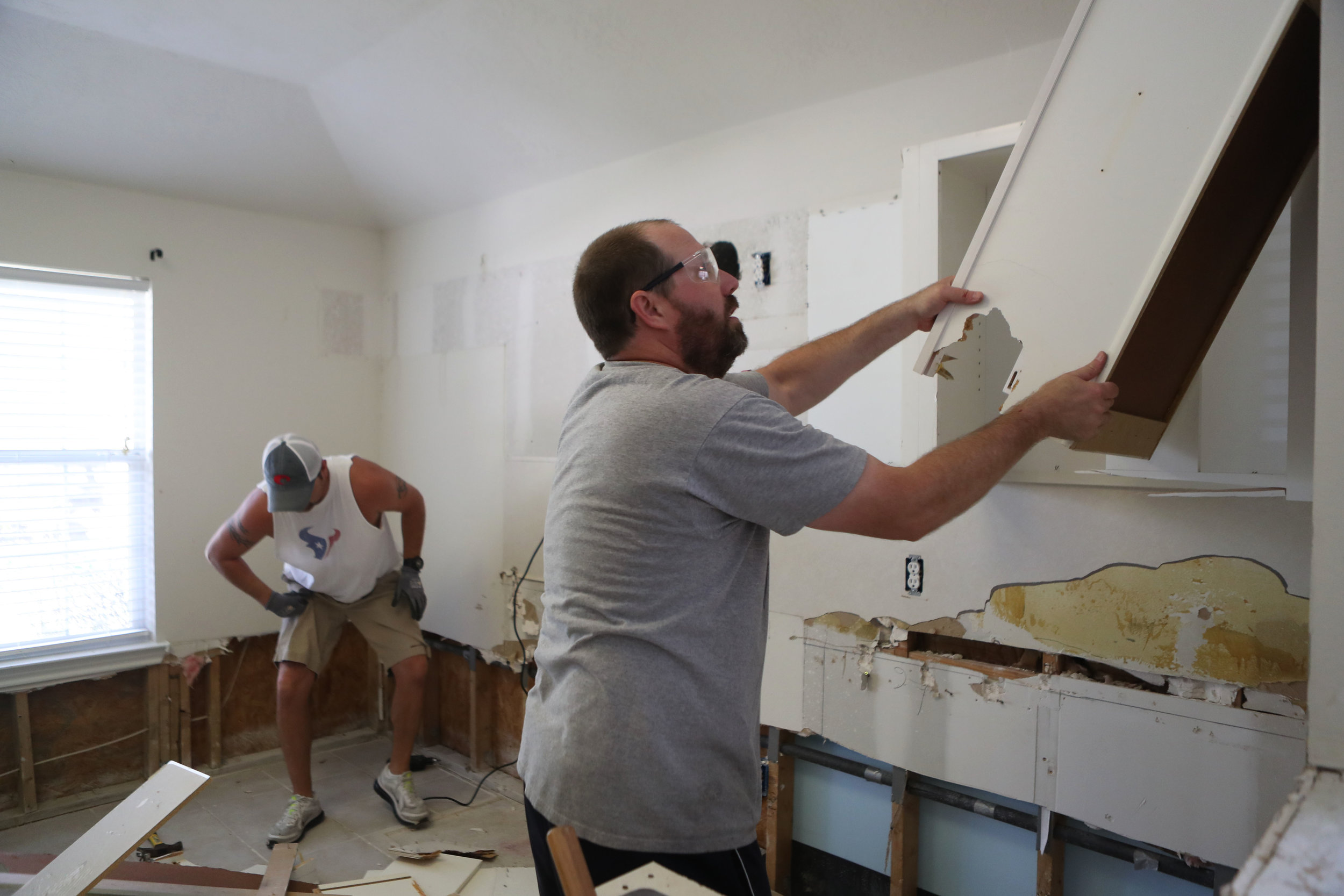 Jimmy Bishop and Rob Haas, a close friend, tear the kitchen apart 26 days after the house flooded on Saturday, Sept. 23, 2017. Jimmy Bishop wanted to take care of most of the demolition, because he knew he would be hiring a contractor for the renovations.