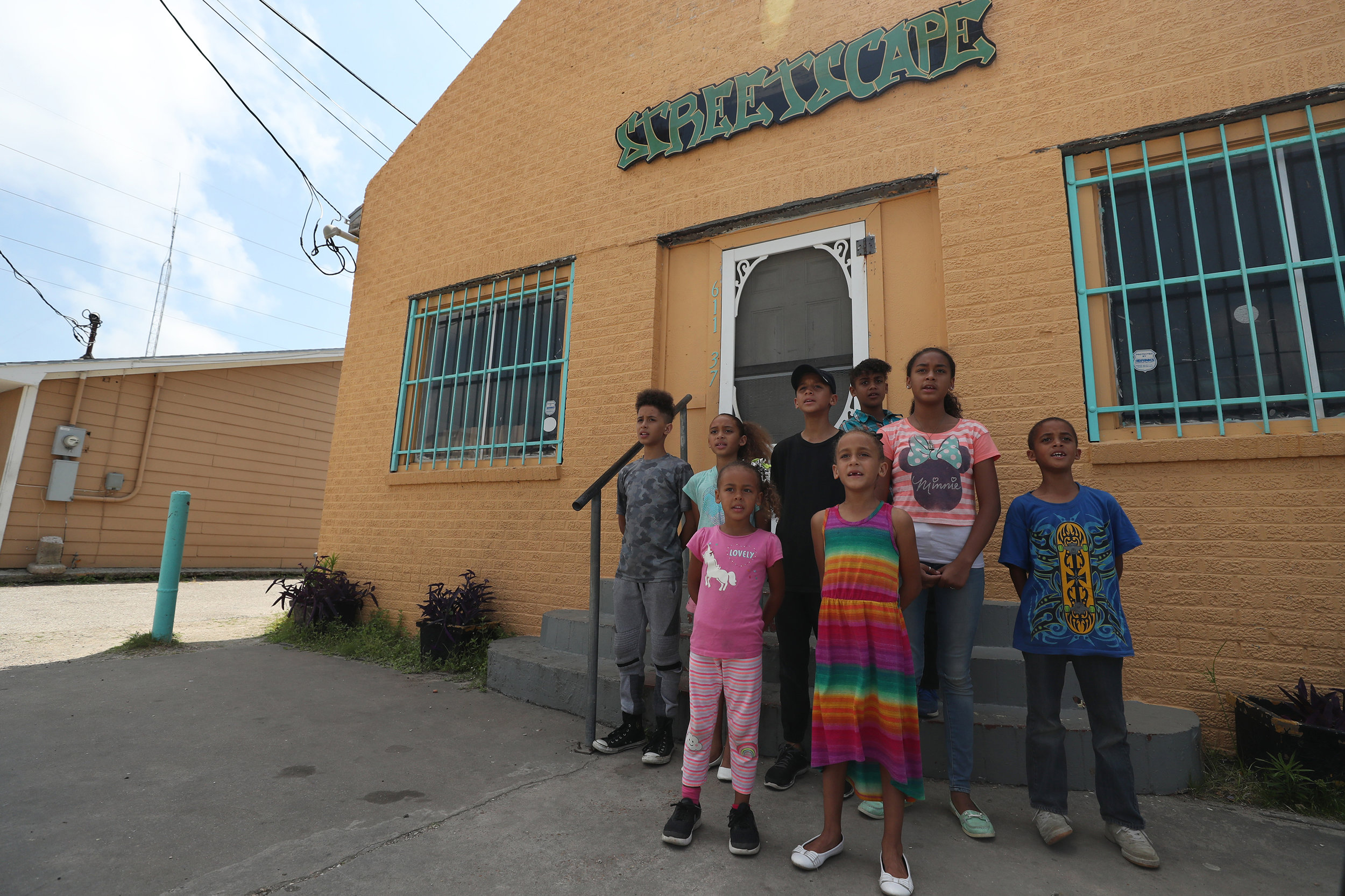 The K White family band practice a song in front of Streetscape Café before traveling to the Meridian for a performance on Friday, May 11, 2018. The eight oldest children have created a choir and perform at special services, churches and other city events.