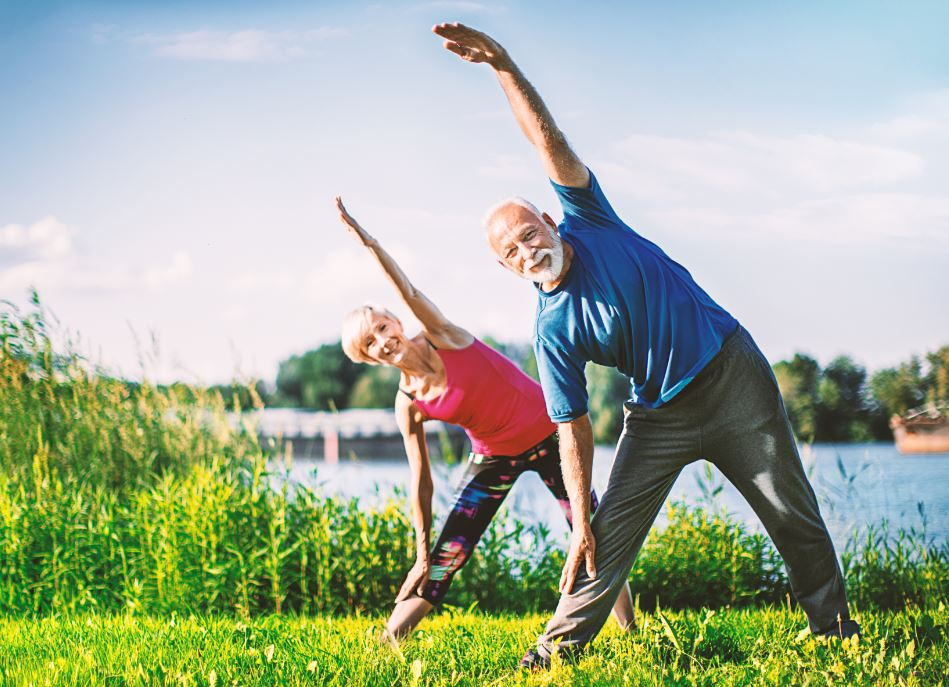 mature-couple-yoga-stretching.JPG